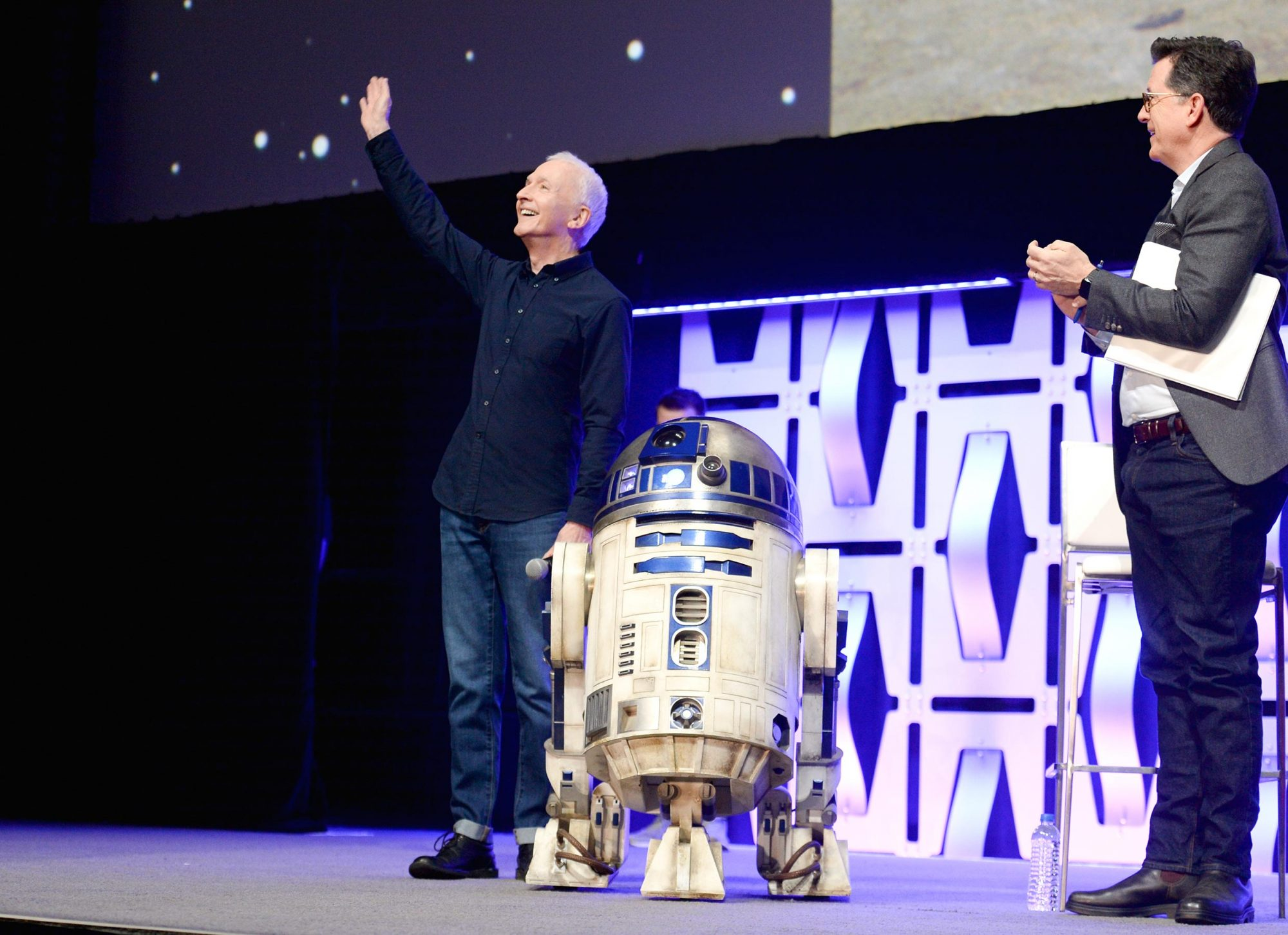 "CHICAGO, IL - APRIL 12: (L-R) Anthony Daniels (C-3PO), R2-D2 and Moderator Stephen Colbert onstage during ""The Rise of Skywalker"" panel at the Star Wars Celebration at McCormick Place Convention Center on April 12, 2019 in Chicago, Illinois. (Photo by Daniel Boczarski/Getty Images for Disney )"