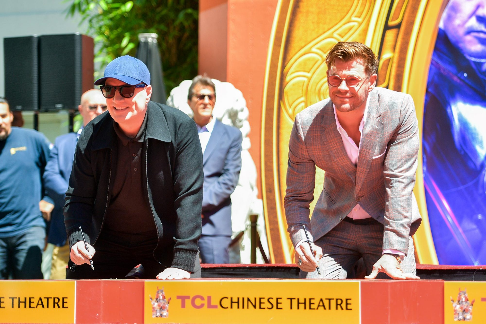HOLLYWOOD, CALIFORNIA - APRIL 23: President of Marvel Studios/Producer Kevin Feige and Chris Hemsworth pose at the Marvel Studios' 'Avengers: Endgame' Cast Place Their Hand Prints In Cement At TCL Chinese Theatre IMAX Forecourt at TCL Chinese Theatre IMAX on April 23, 2019 in Hollywood, California. (Photo by Matt Winkelmeyer/Getty Images)