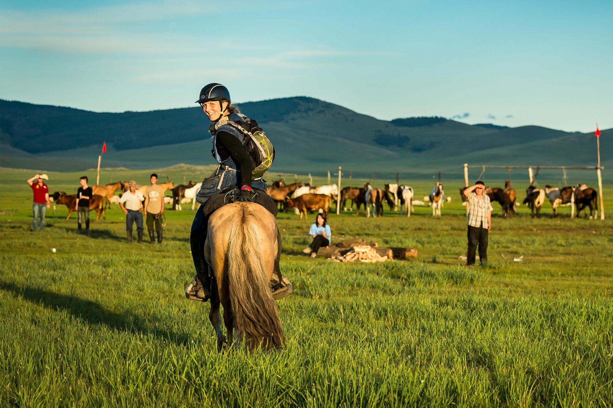 Lara Prior-Palmer on horse looking back - photography credit Richard Dunwoody