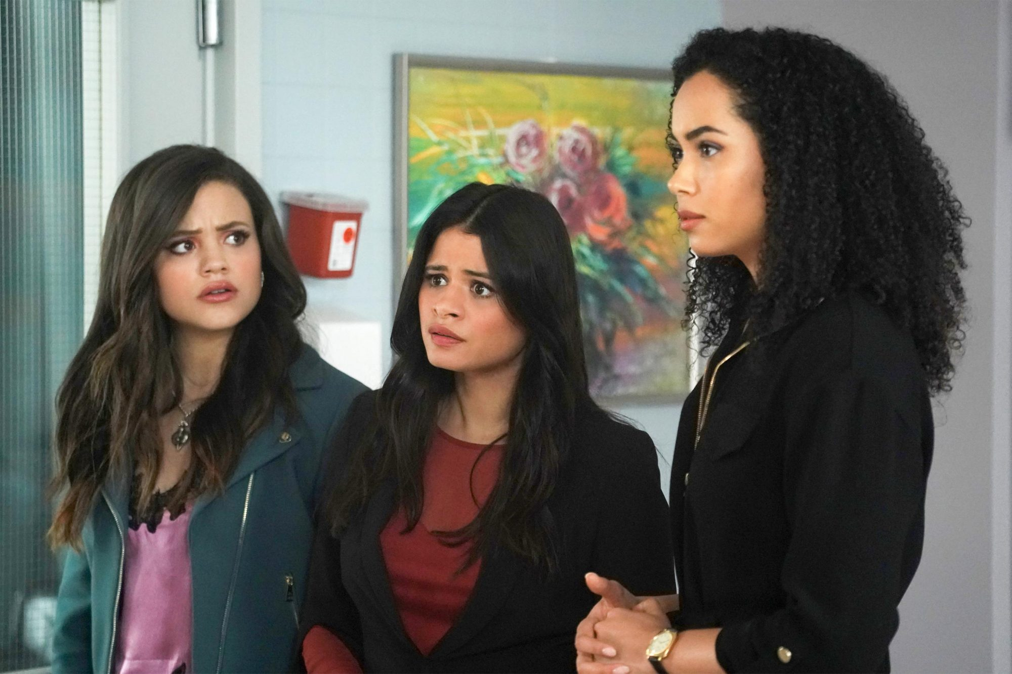 """Charmed -- """"Red Rain"""" -- Image Number: CMD121b_0042.jpg -- Pictured (L-R): Sarah Jeffery as Maggie, Melonie Diaz as Mel and Madeleine Mantock as Macy -- Photo: Shane Harvey/The CW -- © 2019 The CW Network, LLC. All rights reserved."""