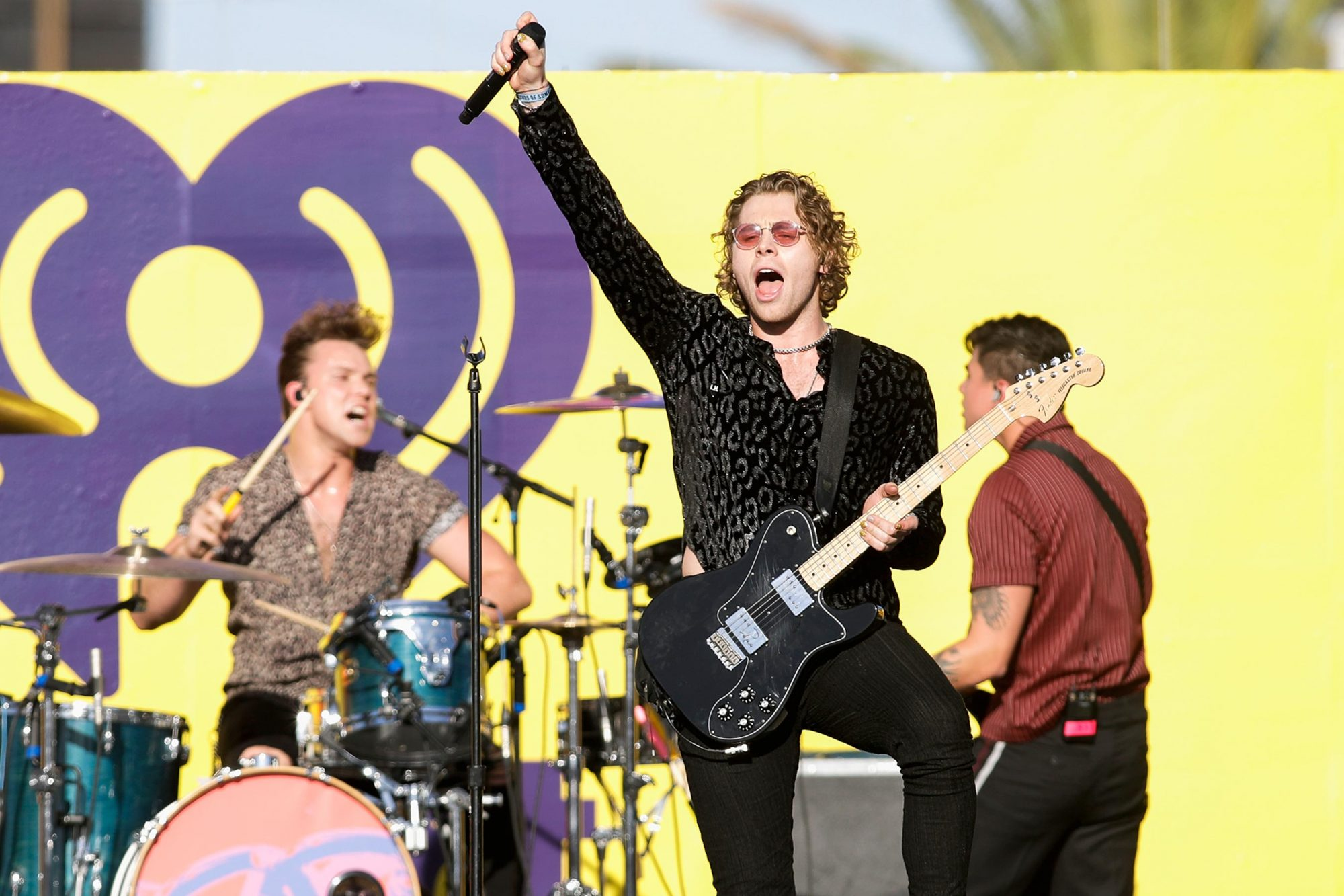 LAS VEGAS, NV - SEPTEMBER 22: (EDITORIAL USE ONLY; NO COMMERCIAL USE) (L-R) Ashton Irwin, Luke Hemmings and Calum Hood of 5 Seconds of Summer perform onstage during the 2018 iHeartRadio Music Festival Daytime Stage at the Las Vegas Festival Grounds on September 22, 2018 in Las Vegas, Nevada. (Photo by Isaac Brekken/Getty Images for iHeartMedia)