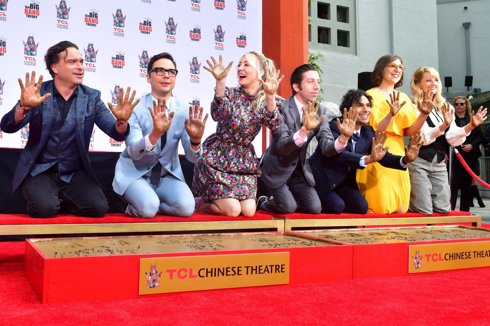 "The cast from the television comedy series ""The Big Bang Theory"" display their hands during Hand and Footprint Ceremony at the TCL Chinese Theater in Hollywood, California on May 1, 2019. - The program's series finale on May 16 ending a run as the longest-running multi camera series in television history. From left to Right are: Johnny Galecki, Jim Parsons, Kaley Cuoco, Simon Helberg, Kunal Nayyar, Mayim Bialik and Melissa Rauch. (Photo by Frederic J. BROWN / AFP) (Photo credit should read FREDERIC J. BROWN/AFP/Getty Images)"