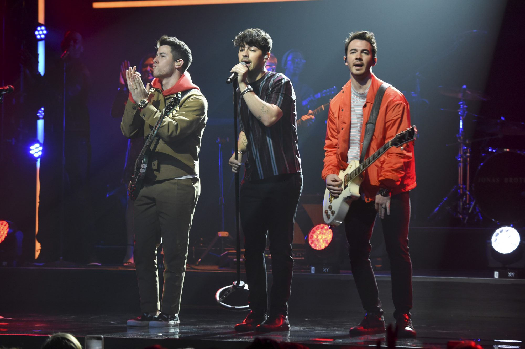NEW YORK, NEW YORK - MAY 16: (L-R) Nick Jonas, Joe Jonas, and Kevin Jonas of The Jonas Brothers speak onstage during the The CW Network 2019 Upfronts at New York City Center on May 16, 2019 in New York City. (Photo by Kevin Mazur/Getty Images for The CW Network)