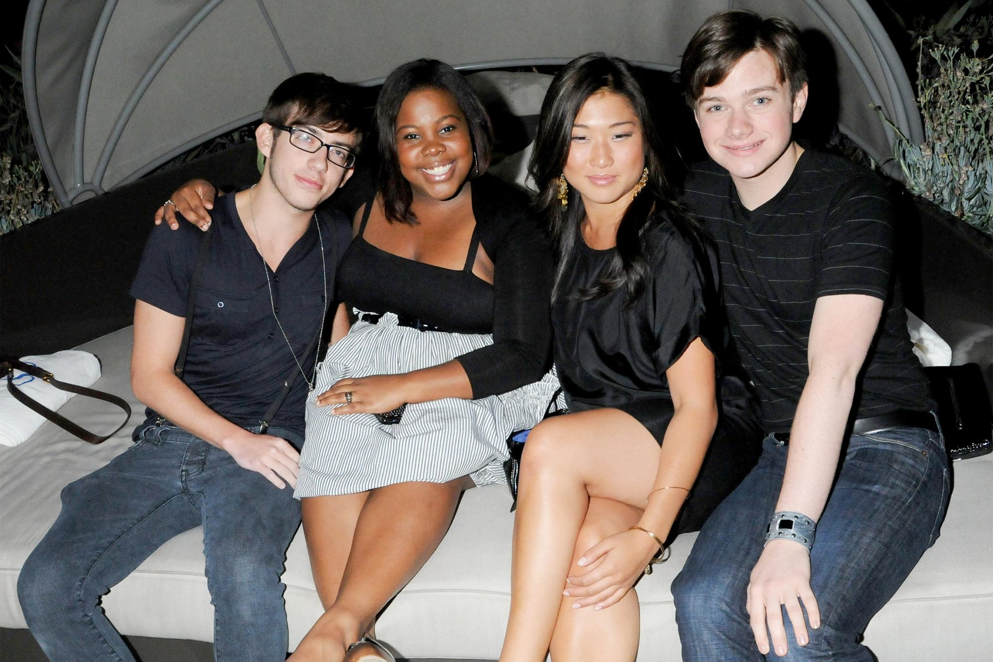 "WEST HOLLYWOOD, CA - AUGUST 13: Kevin McHale, Amber Riley, Jenna Ushkowitz and Chris Colfer, of Fox TV show ""Glee"", arrive at the Rolling Stone ""Rock The Roof"" Party held at the Andaz Hotel in West Hollywood, California on August 13, 2009. (Photo by Gregg DeGuire/FilmMagic)"