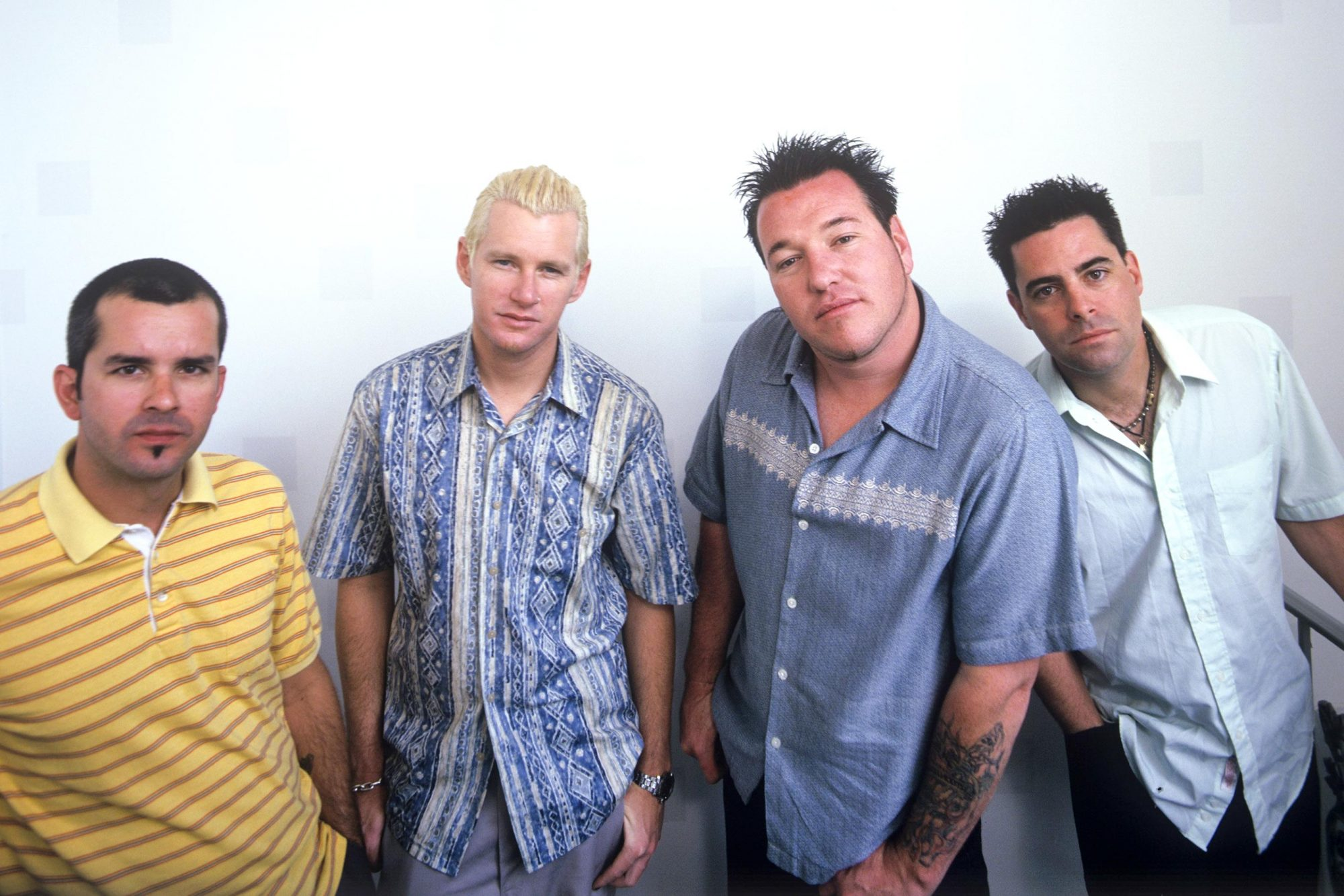 LOS ANGELES - MAY 1999: (EDITORS NOTE: THIS IMAGE WAS CREATED USING COLOR INFRARED FILM) American rock band Smash Mouth (L - R) guitarist Greg Camp, drummer Kevin Coleman, bassist Paul De Lisle and vocalist Steven Harwell pose for a May 1999 portrait in Los Angeles, California. (Photo by Bob Berg/Getty Images)