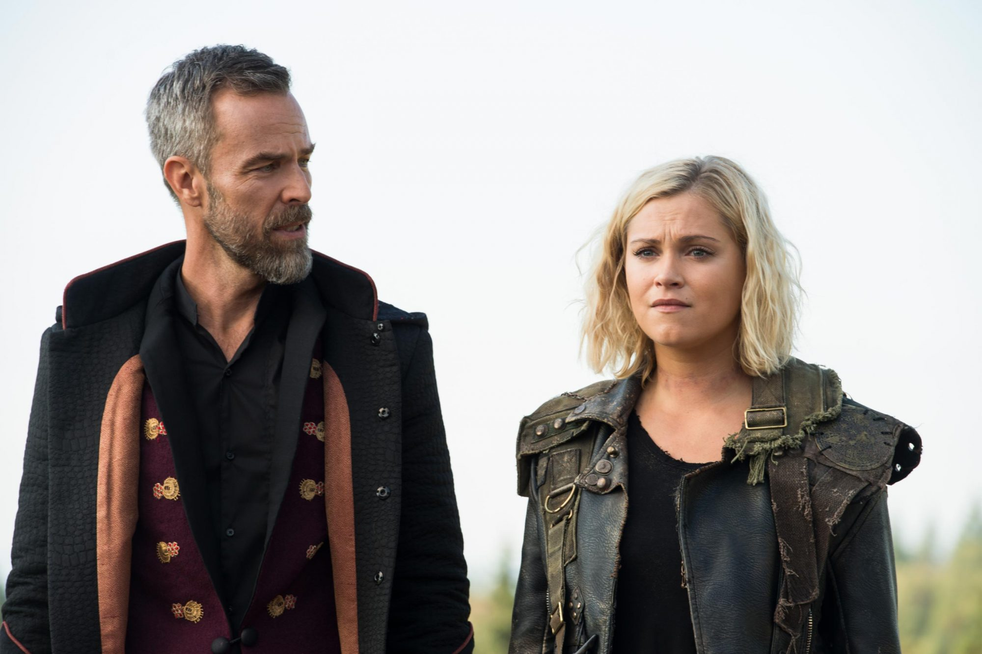 "The 100 -- ""The Children of Gabriel"" -- Image Number: HU603a_0050b.jpg -- Pictured (L-R): JR Bourne as Russel VII and Eliza Taylor as Clarke -- Photo: Diyah Pera/The CW -- © 2019 The CW Network, LLC. All rights reserved."