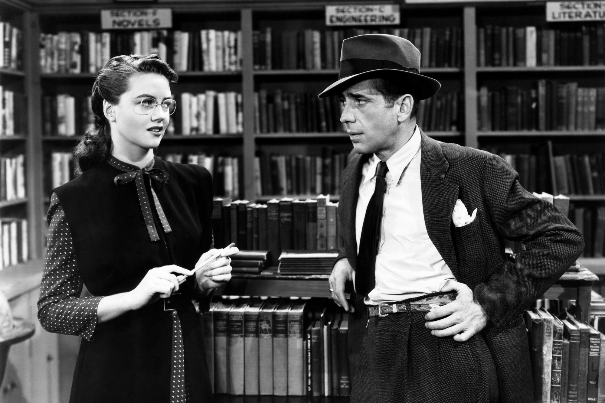 THE BIG SLEEP, from left, Dorothy Malone, Humphrey Bogart, 1946