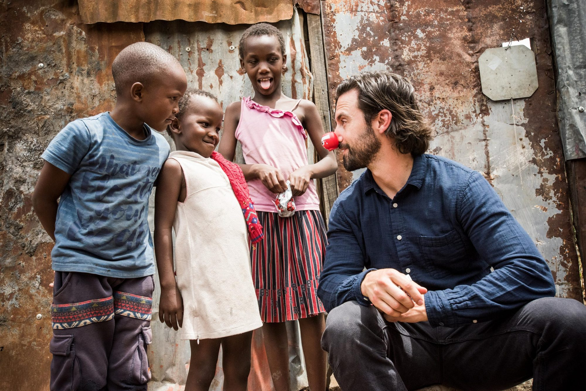 THE RED NOSE DAY SPECIAL -- Red Nose Day -- Pictured: Milo Ventimiglia in Kenya Visiting Red Nose Day-Funded Programs on April 24, 2019 -- (Photo by: Mia Collis/Comic Relief Inc.)
