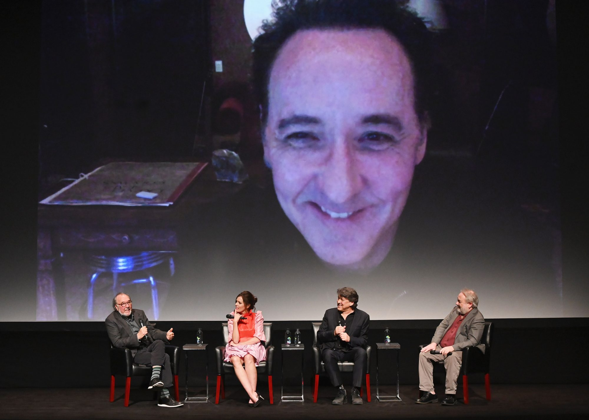 """NEW YORK, NEW YORK - APRIL 30: A live skype feed with, John Cusack, Executive Producer James L. Brooks, Ione Skye, Director Cameron Crowe and moderator David Edelstein speak at the screening of """"Say Anything..."""" 30th Anniversary - 2019 Tribeca Film Festival at BMCC Tribeca PAC on April 30, 2019 in New York City. (Photo by Nicholas Hunt/Getty Images for Tribeca Film Festival)"""