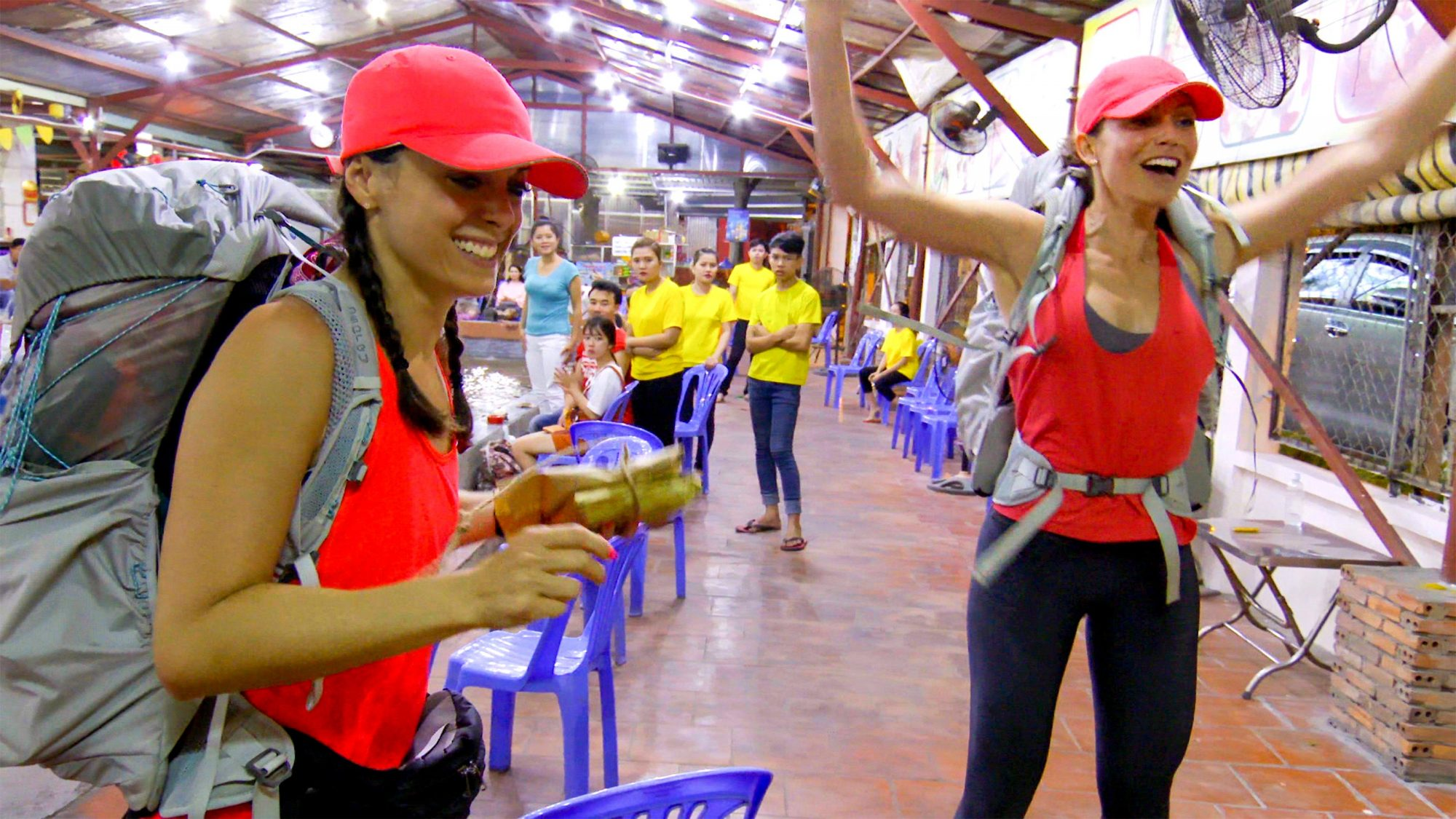 """Here Fishy, Fishy""- Pictured L-R: Eliza Orlins and Corinne Kaplan of THE AMAZING RACE airing Wednesday, May 1 (9:00-10:00 PM, ET/PT) on the CBS Television Network. Photo: CBS ©2019 CBS Broadcasting, Inc. All Rights Reserved"