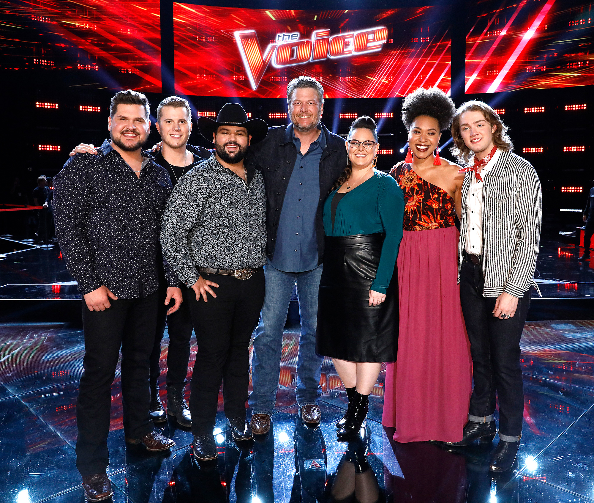 "THE VOICE -- ""Live Top 24 Results"" Episode 1613B -- Pictured: (l-r) Dexter Roberts, Gyth Rigdon, Andrew Sevener, Blake Shelton, Kim Cherry, Oliv Blu, Carter Lloyd Horne -- (Photo by: Trae Patton/NBC)"