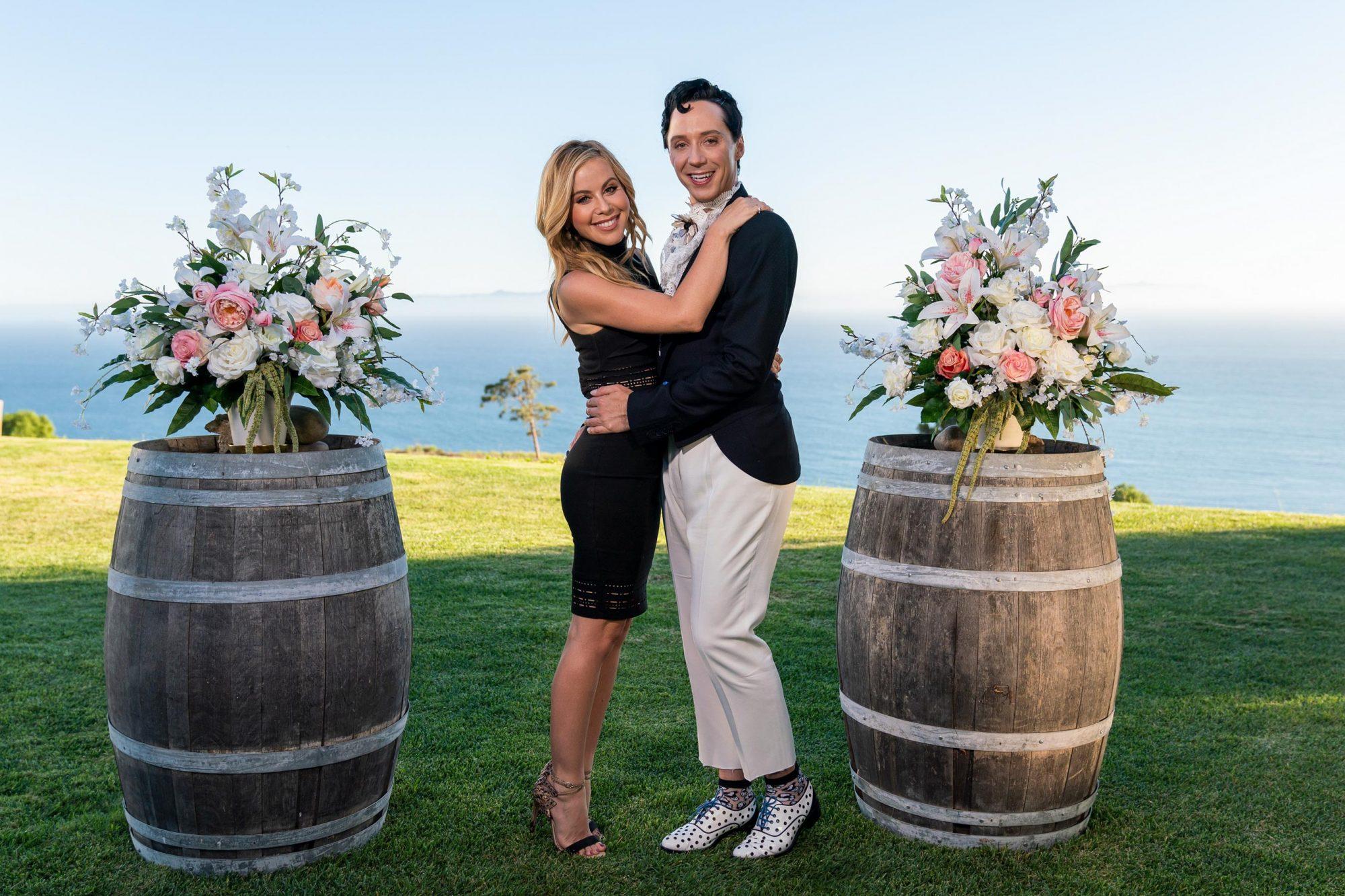 Hosts Tara Lipinski and Johnny Weir, as seen on Wedding Cake Championship, Season 2. CR: Anders Krusberg/Food Network