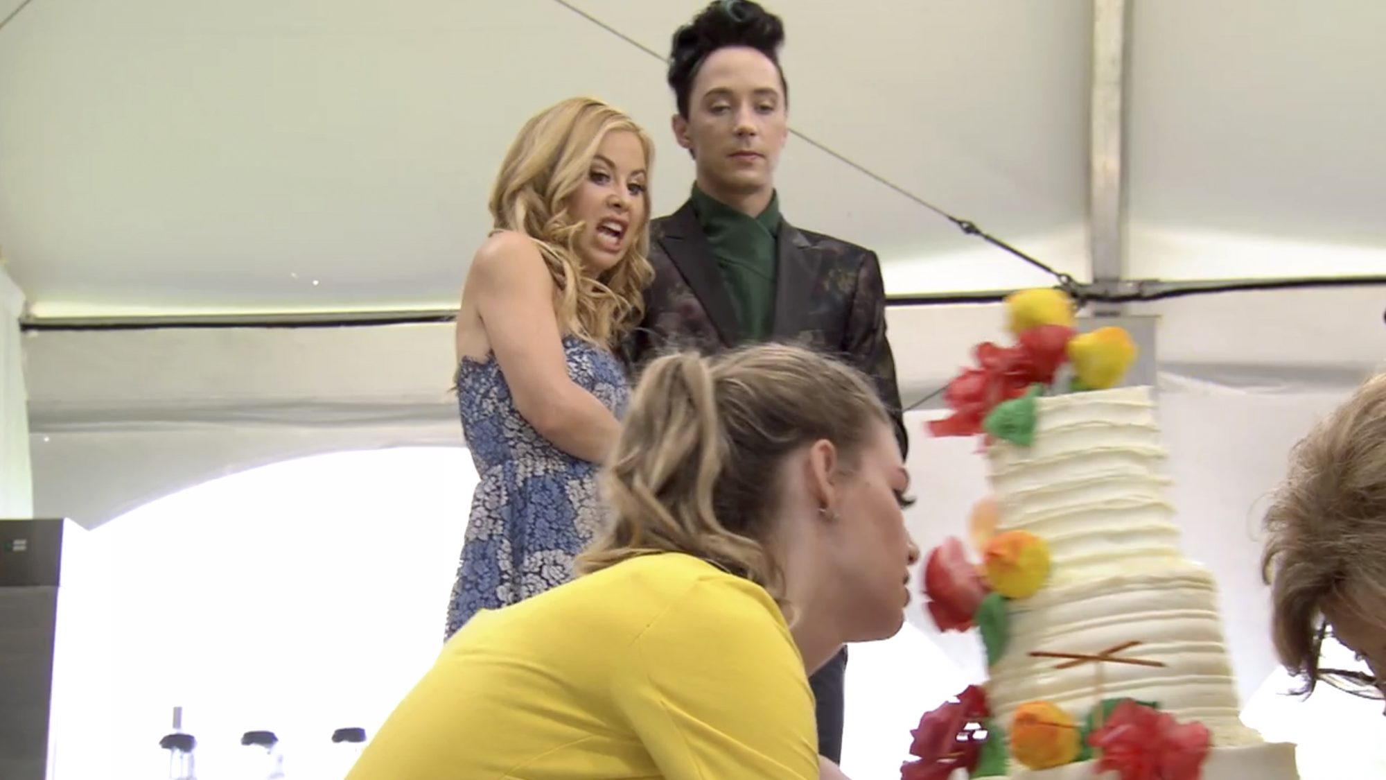 Hosts Tara Lipinski and Johnny Weir, as seen on Wedding Cake Championship, Season 2. (screen grab) https://timeincsecure-a.akamaihd.net/rtmp_uds/219646971/201905/2101/219646971_6039464062001_6039465909001.mp4?pubId=219646971&videoId=6039465909001 CR: Food Network