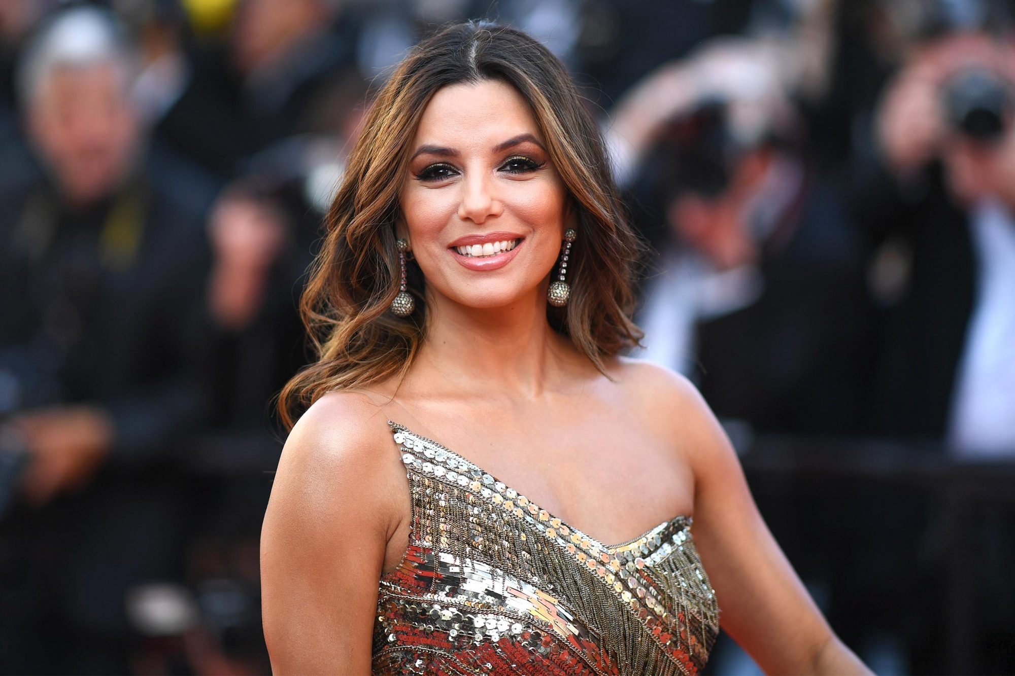 "TOPSHOT - US actress Eva Longoria smiles as she arrives for the screening of the film ""Rocketman"" at the 72nd edition of the Cannes Film Festival in Cannes, southern France, on May 16, 2019. (Photo by LOIC VENANCE / AFP) (Photo credit should read LOIC VENANCE/AFP/Getty Images)"