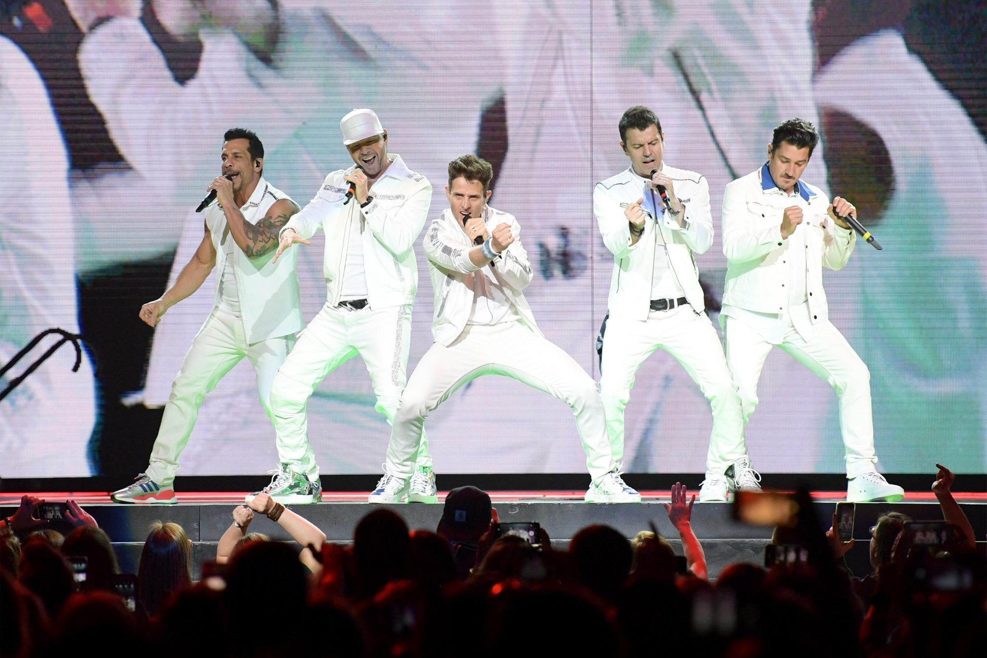 NASHVILLE, TENNESSEE - MAY 09: Danny Wood, Donnie Wahlberg, Joey McIntyre, Jordan Knight and Jonathan Knight of the musical group New Kids On The Block perform at Bridgestone Arena on May 09, 2019 in Nashville, Tennessee. (Photo by Jason Kempin/Getty Images)