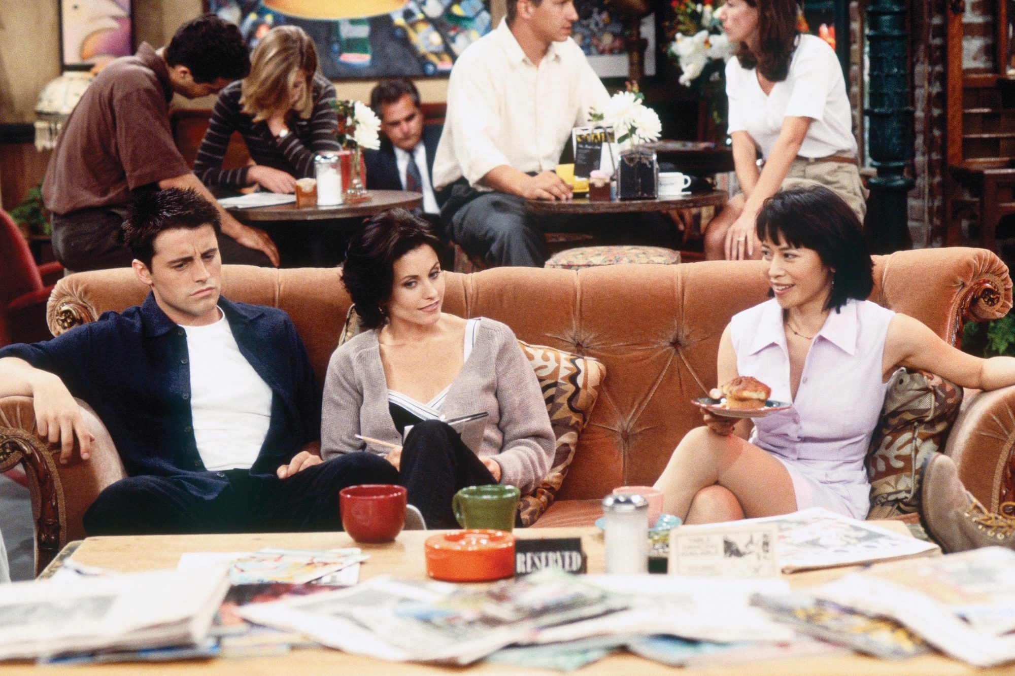 "FRIENDS -- ""The One With the Breast Milk"" Episode 2 -- Pictured: (l-r) Matt Le Blanc as Joey Tribbiani, Courteney Cox as Monica Geller, Lauren Tom as Julie (Photo by Gary Null/NBC/NBCU Photo Bank via Getty Images)"