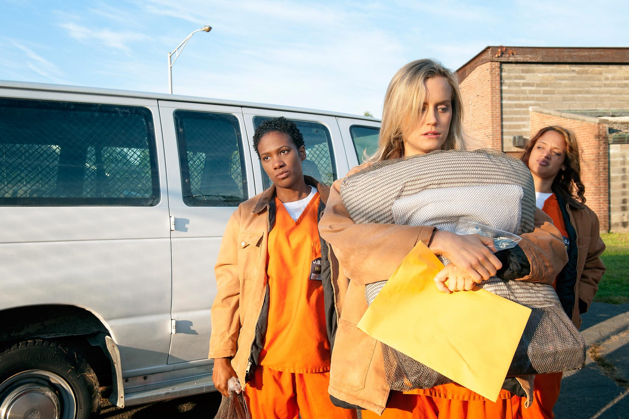 """Orange is the new black """"I Wasn't Ready"""" Season 1 Episode 1 July 11, 2013 Taylor Schilling (front), Vicky Jeudy (back left) and Dascha Polanco"""