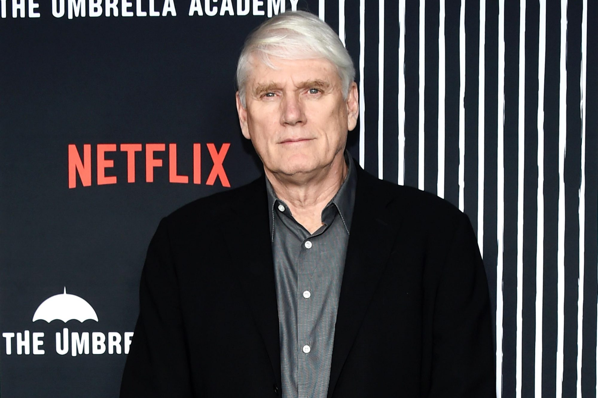 """HOLLYWOOD, CALIFORNIA - FEBRUARY 12: Mike Richardson arrives at the premiere of Netflix's """"The Umbrella Academy"""" at the ArcLight Hollywood on February 12, 2019 in Hollywood, California. (Photo by Amanda Edwards/WireImage)"""