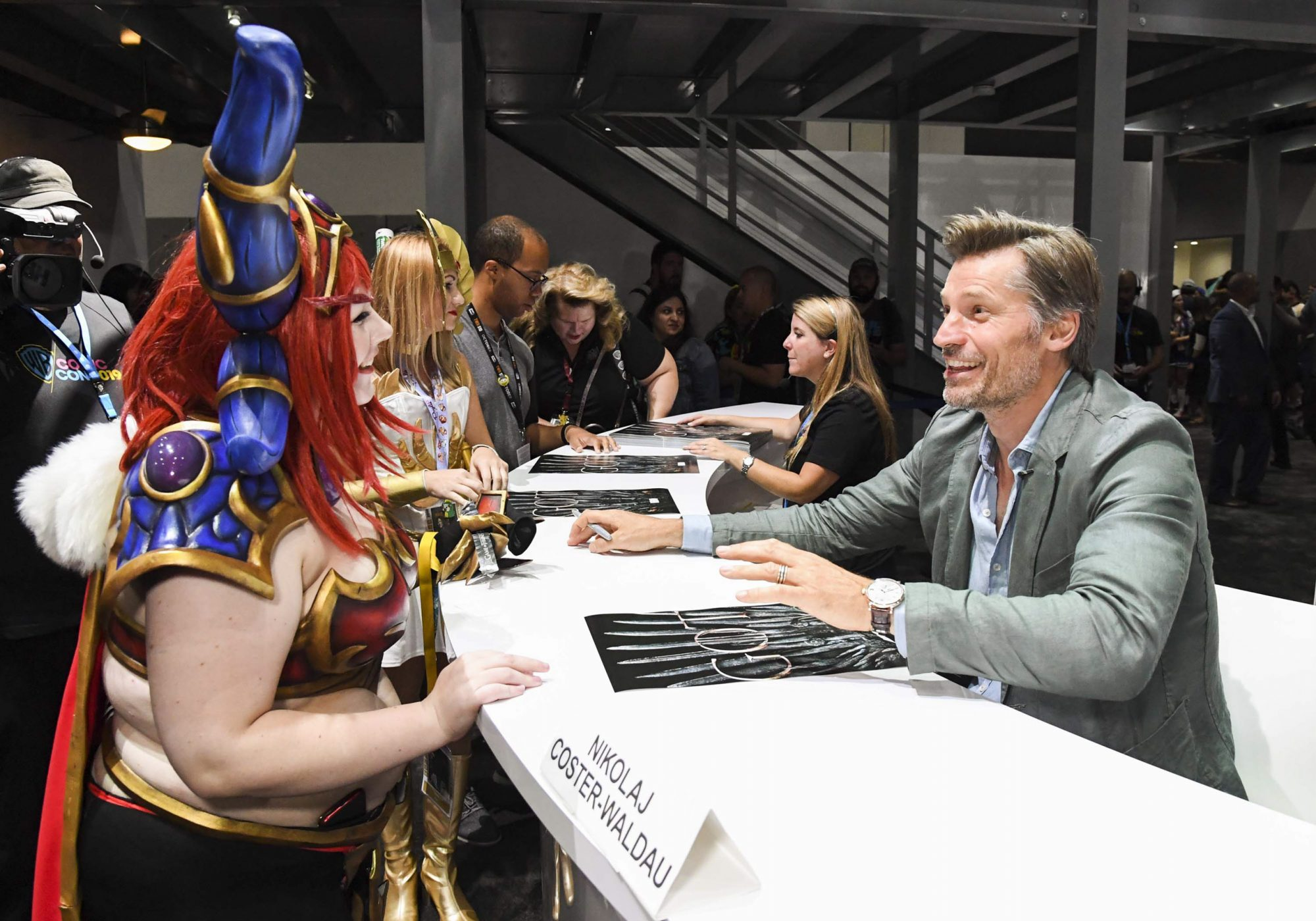 """SAN DIEGO, CALIFORNIA - JULY 19: Nikolaj Coster-Waldau at """"Game Of Thrones"""" Comic Con Autograph Signing 2019 on July 19, 2019 in San Diego, California. (Photo by Jeff Kravitz/FilmMagic for HBO)"""