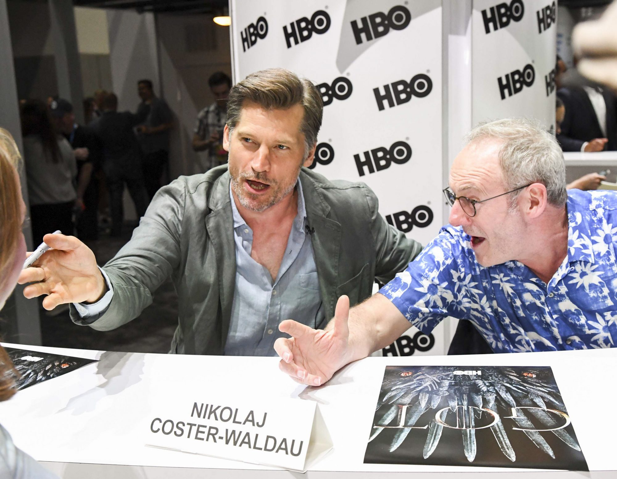 """SAN DIEGO, CALIFORNIA - JULY 19: Nikolaj Coster-Waldau and Liam Cunningham at """"Game Of Thrones"""" Comic Con Autograph Signing 2019 on July 19, 2019 in San Diego, California. (Photo by Jeff Kravitz/FilmMagic for HBO)"""