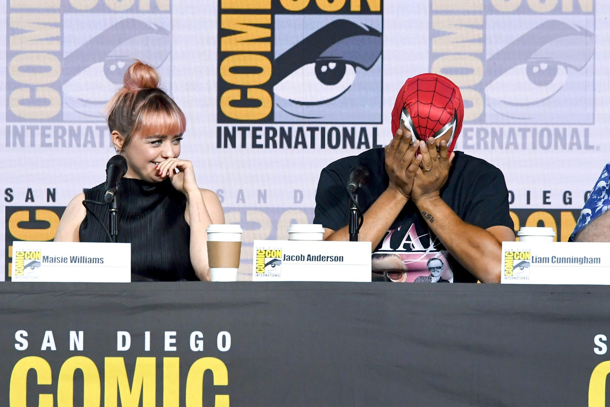 """SAN DIEGO, CALIFORNIA - JULY 19: (L-R) Maisie Williams and Jacob Anderson speak at the """"Game Of Thrones"""" Panel And Q&A during 2019 Comic-Con International at San Diego Convention Center on July 19, 2019 in San Diego, California. (Photo by Kevin Winter/Getty Images)"""