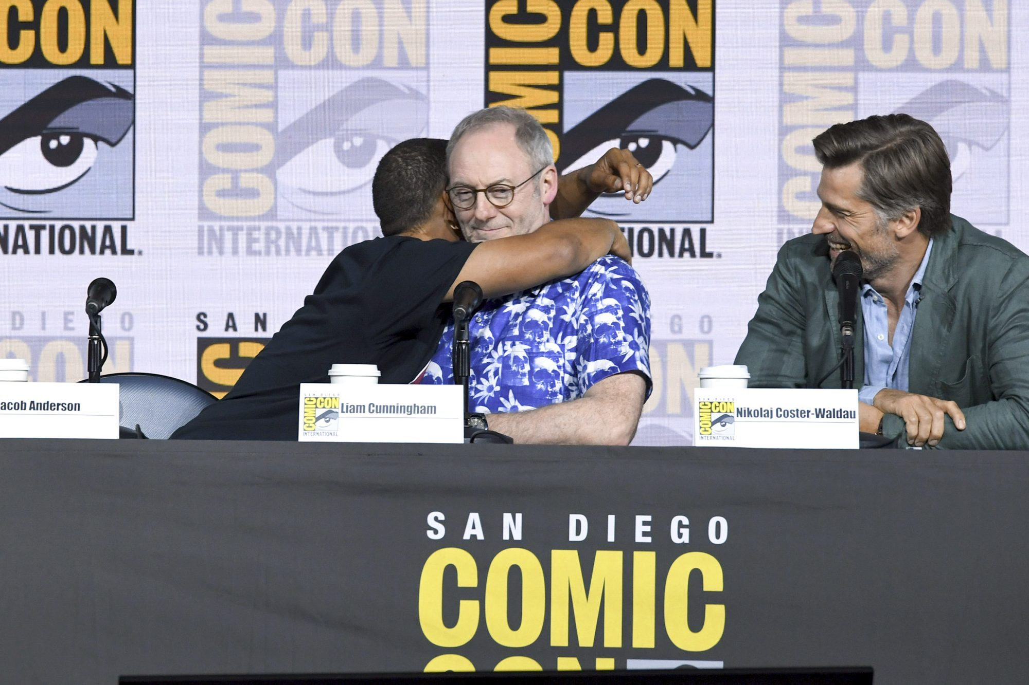 """SAN DIEGO, CALIFORNIA - JULY 19: (L-R) Maisie Williams, Jacob Anderson, Liam Cunningham, and Nikolaj Coster-Waldau speak at the """"Game Of Thrones"""" Panel And Q&A during 2019 Comic-Con International at San Diego Convention Center on July 19, 2019 in San Diego, California. (Photo by Kevin Winter/Getty Images)"""