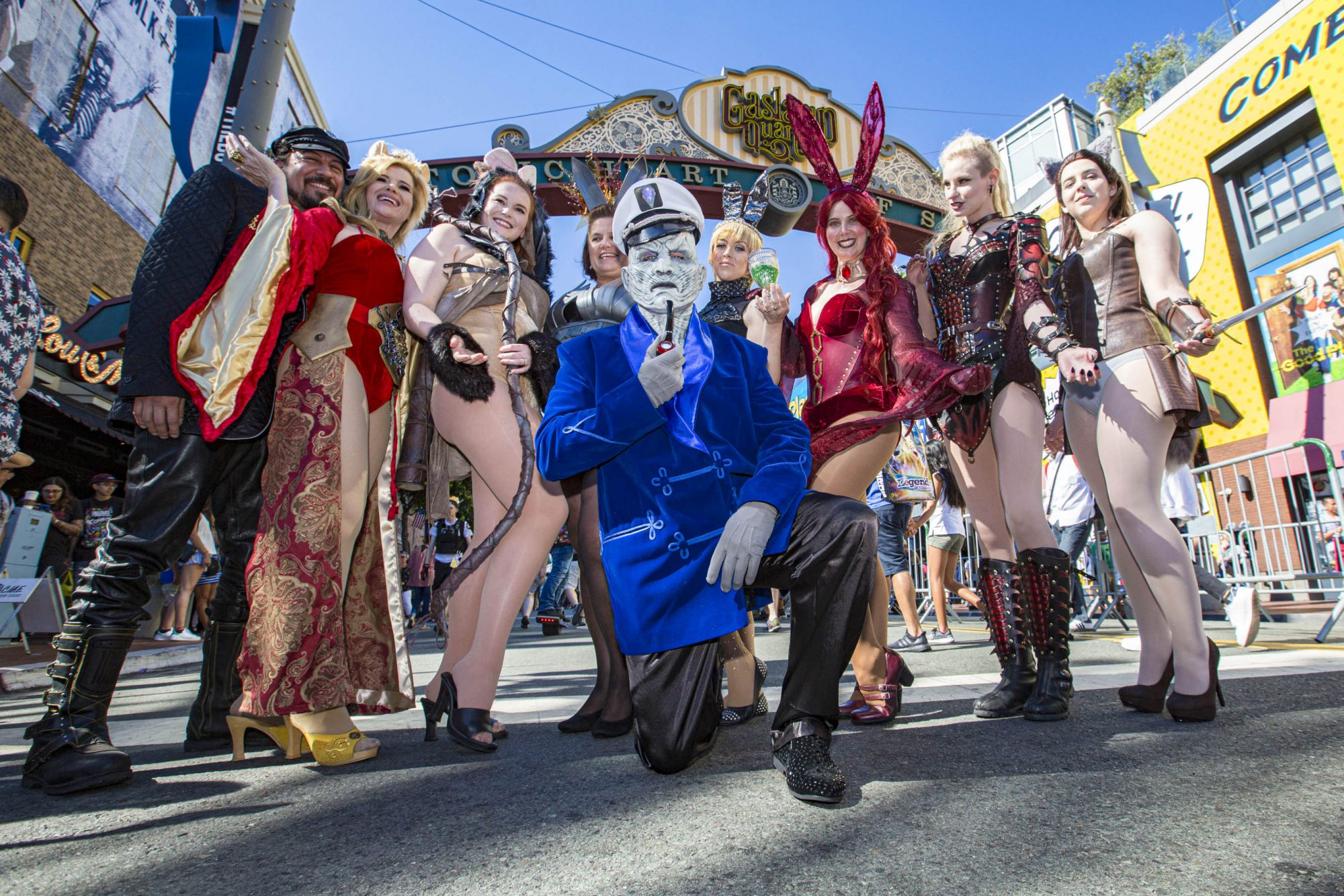 SAN DIEGO, CALIFORNIA - JULY 19: Cosplayers from the San Diego Comic-Con Game Of Thrones Bunny Hutch pose for photos under the iconic Gaslamp District sign outside 2019 Comic-Con International on July 19, 2019 in San Diego, California. (Photo by Daniel Knighton/Getty Images)