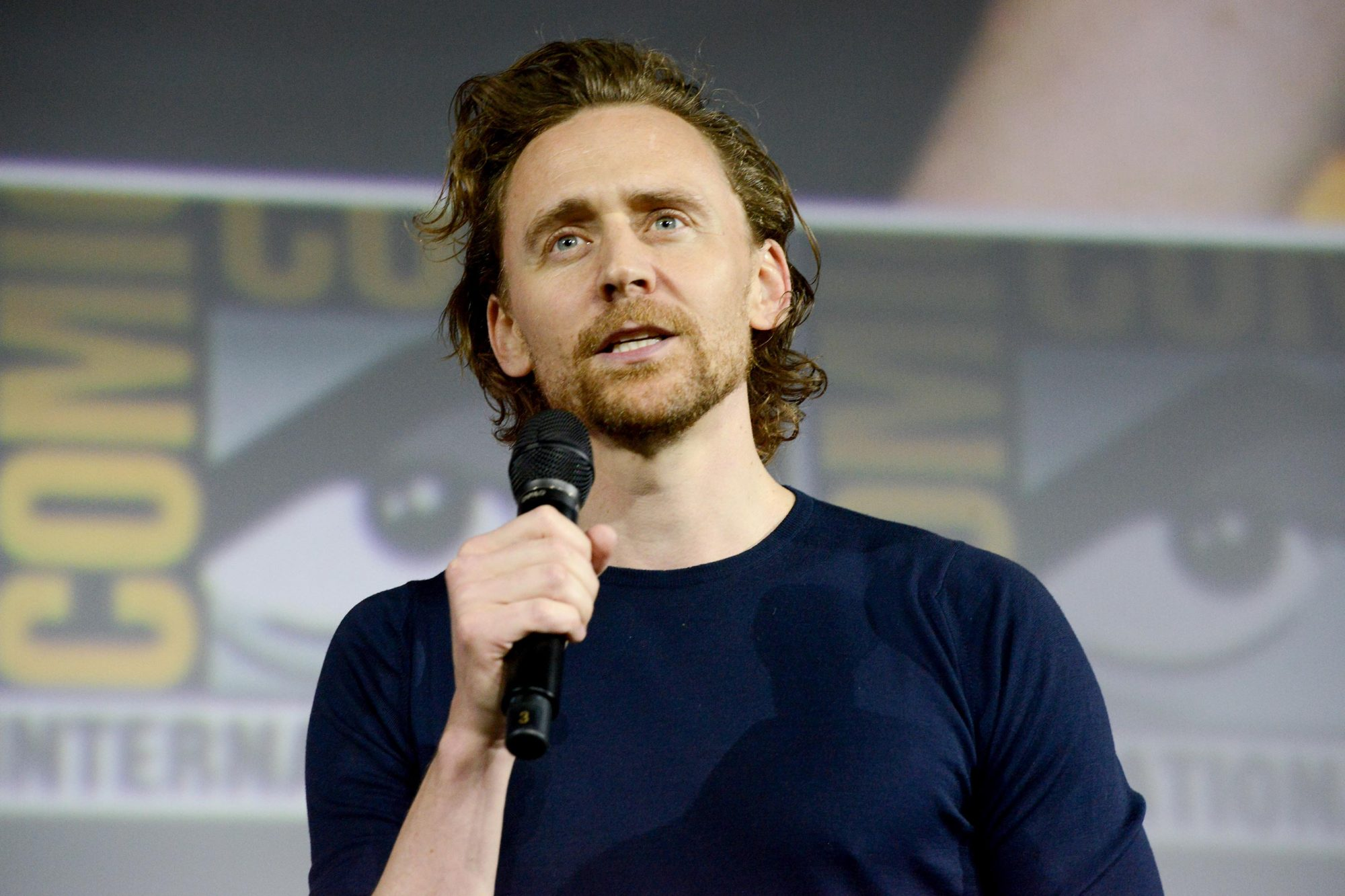 SAN DIEGO, CALIFORNIA - JULY 20: Tom Hiddleston speaks at the Marvel Studios Panel during 2019 Comic-Con International at San Diego Convention Center on July 20, 2019 in San Diego, California. (Photo by Albert L. Ortega/Getty Images)