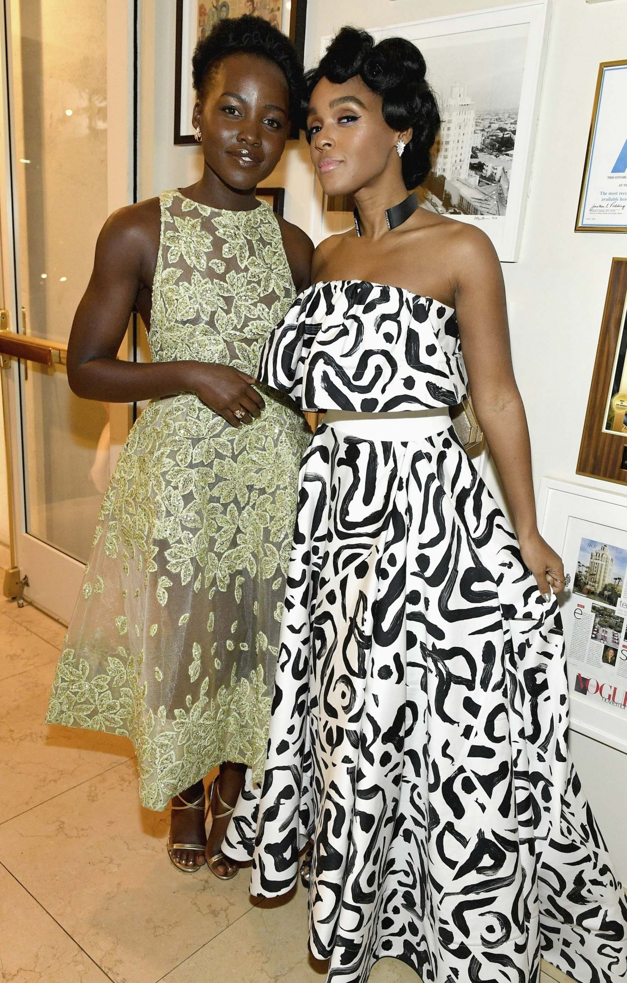 LOS ANGELES, CA - NOVEMBER 12: Actresses Lupita Nyong'o (L) and Janelle Monae attend a special event hosted by Paramount Pictures' Brad Grey with stars from the studio?s films on Saturday, November 12th at the Tower Bar in Los Angeles. (Photo by Mike Windle/Getty Images for Paramount Pictures)