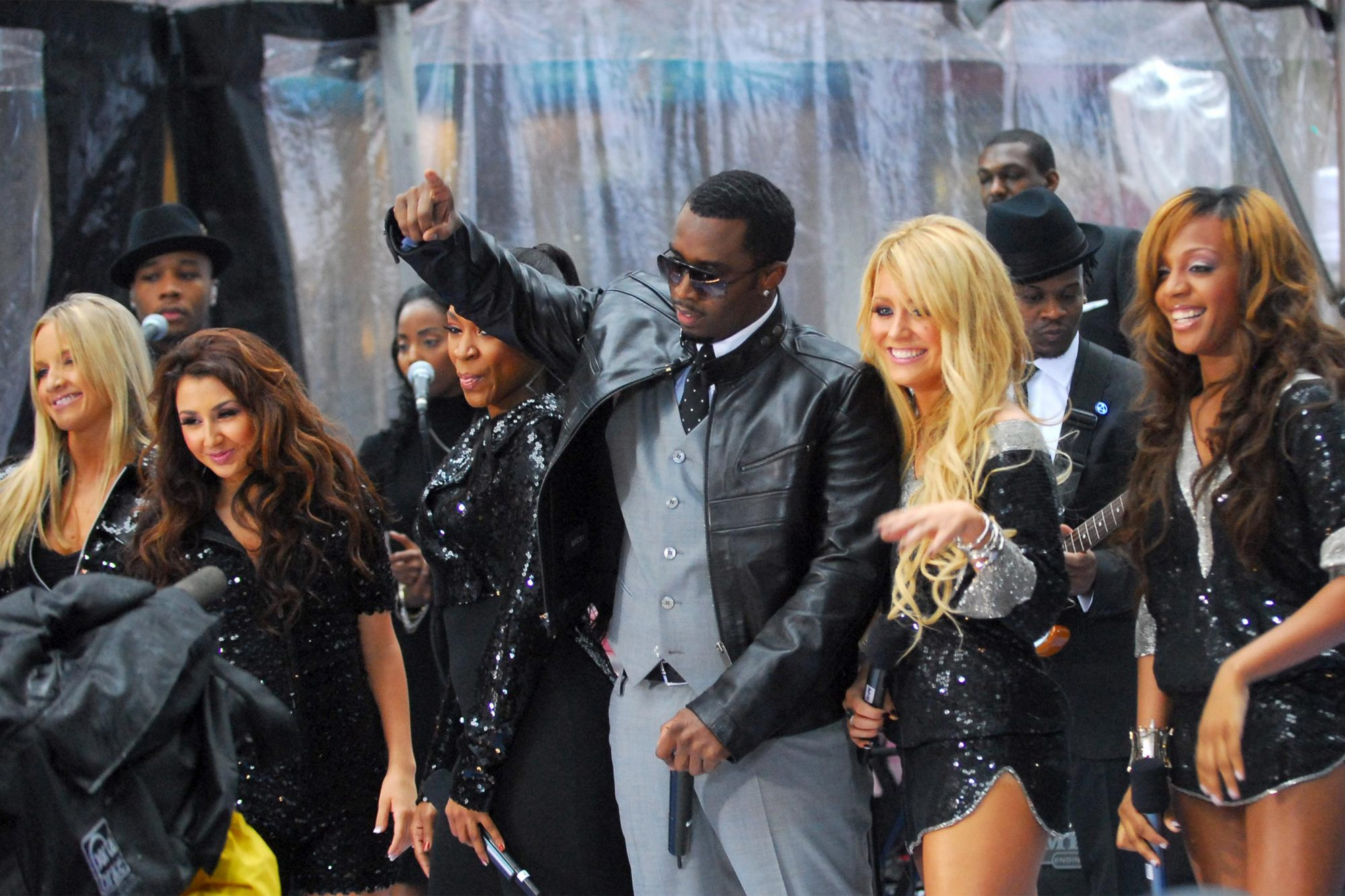 "Diddy (center) and Shannon Bex, Aundrea Fimbres, Wanita ""D. Woods"" Woodgette, Aubrey O'Day and Dawn Richard (Danity Kane of ""Making The Band 3"") (Photo by Michael Loccisano/FilmMagic)"