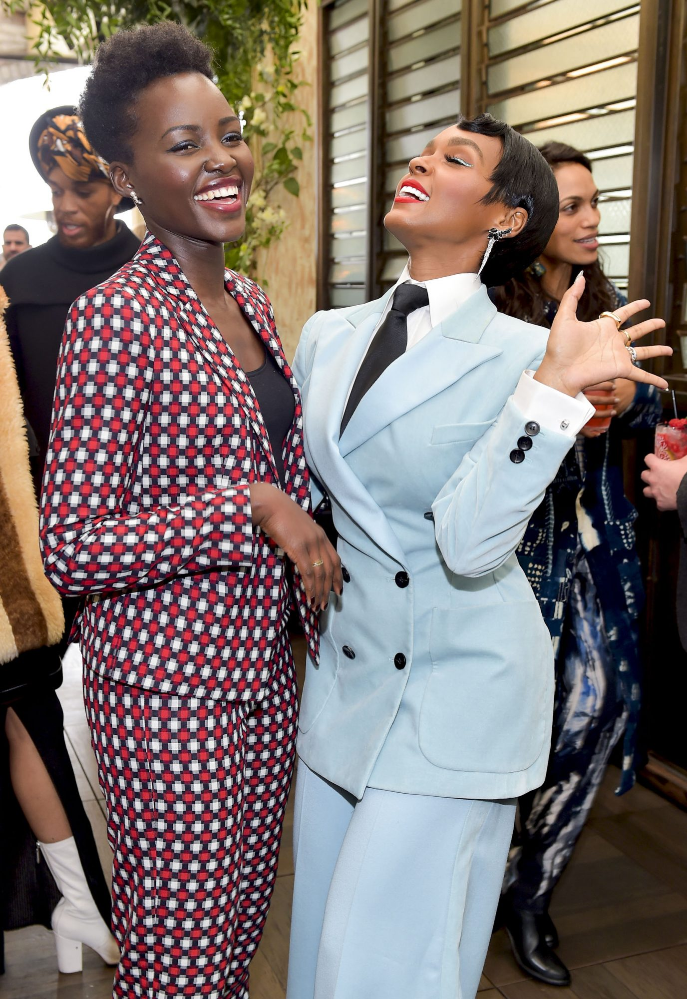 """WEST HOLLYWOOD, CA - MARCH 02: Actors Lupita Nyong'o and Janelle Monae pose as Janelle Monae and Belvedere Vodka kick-off """"A Beautiful Future"""" Campaign with Fem the Future Brunch at Catch LA on March 2, 2018 in West Hollywood, California. (Photo by Donato Sardella/Getty Images for Belvedere Vodka)"""