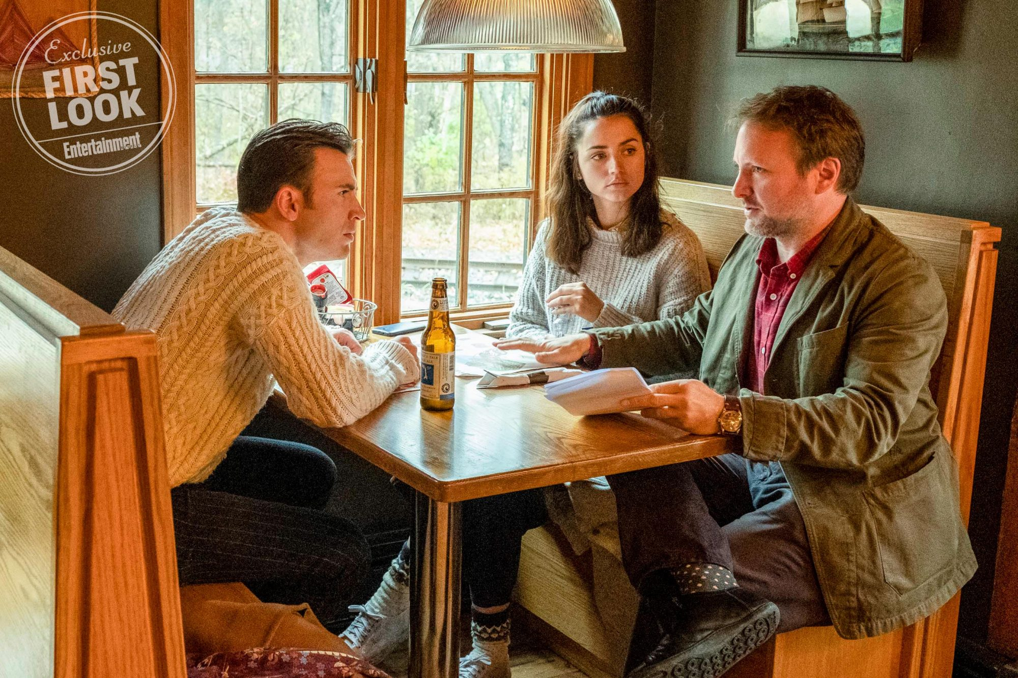 KNIVES OUT Chris Evans (left), Ana de Armas (center) and Director Rian Johnson on the set of KNIVES OUT. CR: Claire Folger/Lionsgate