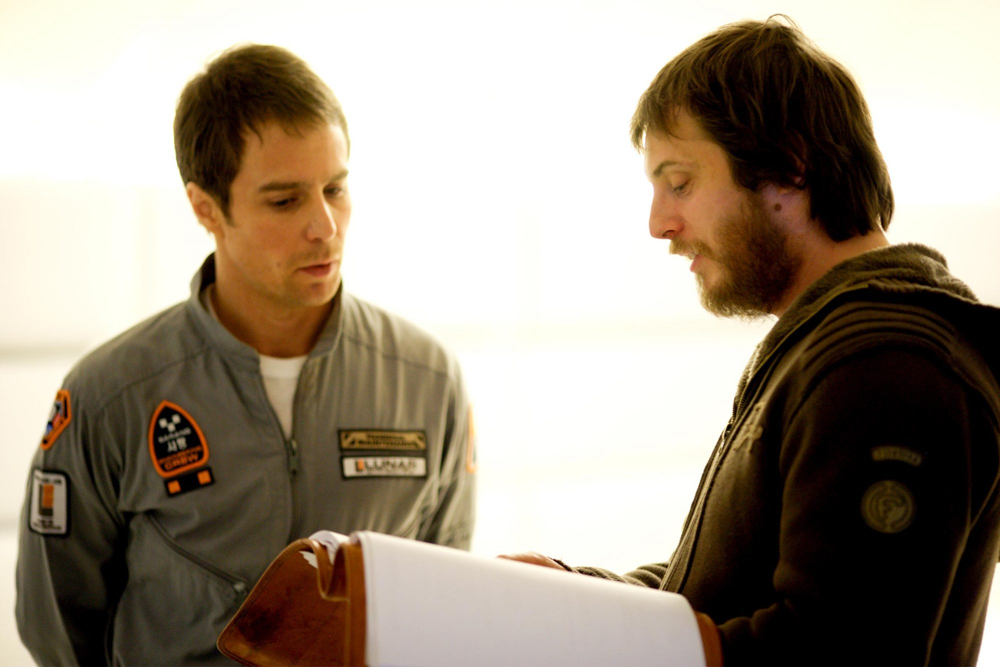 MOON, from left: Sam Rockwell, director Duncan Jones, on set, 2009. PH: Mark Tille/©Sony Pictures Classics/Courtesy Everett Collection