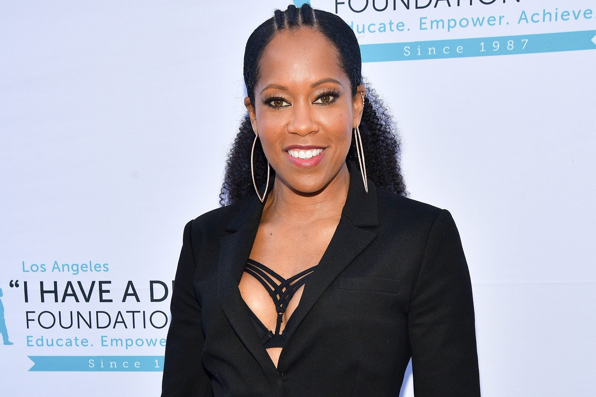 Regina King Making Feature Directorial Debut With Young Muhammad Ali Movie Ew Com