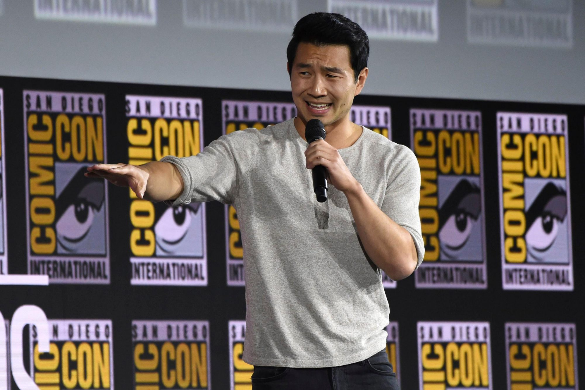 """Mandatory Credit: Photo by Chris Pizzello/Invision/AP/Shutterstock (10342701af) Simu Liu speaks during the """"Shang-Chi and The Legend of the Ten Rings"""" portion of the Marvel Studios panel on day three of Comic-Con International, in San Diego 2019 Comic-Con - Marvel Studios, San Diego, USA - 20 Jul 2019"""