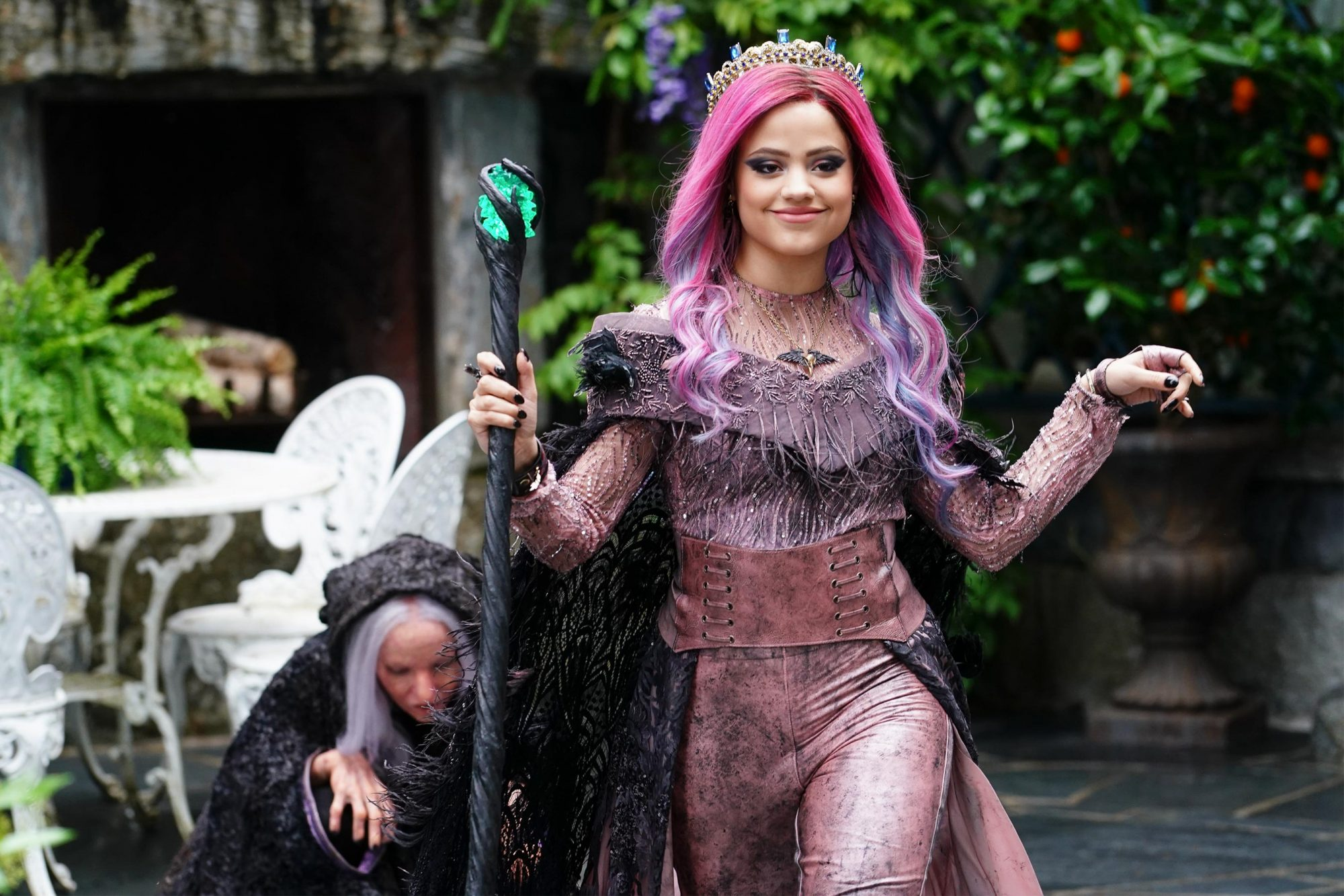 "DESCENDANTS 3 - This highly anticipated third installment in the global hit Disney Channel Original Movie franchise continues the contemporary saga of good versus evil as the teenage daughters and sons of Disney's most infamous villains-Mal, Evie, Carlos and Jay (also known as the villain kids or VKs)-return to the Isle of the Lost to recruit a new batch of villainous offspring to join them at Auradon Prep. When a barrier breach jeopardizes the safety of Auradon during their departure off the Isle, Mal resolves to permanently close the barrier, fearing that nemeses Uma and Hades will wreak vengeance on the kingdom. Despite her decision, an unfathomable dark force threatens the people of Auradon and it's up to Mal and the VKs to save everyone in their most epic battle yet. ""Descendants 3"" is set to premiere on FRIDAY, AUG. 2 (8:00-10:00 p.m. EDT), on Disney Channel and DisneyNOW. (Disney Channel/David Bukach) SARAH JEFFERY"