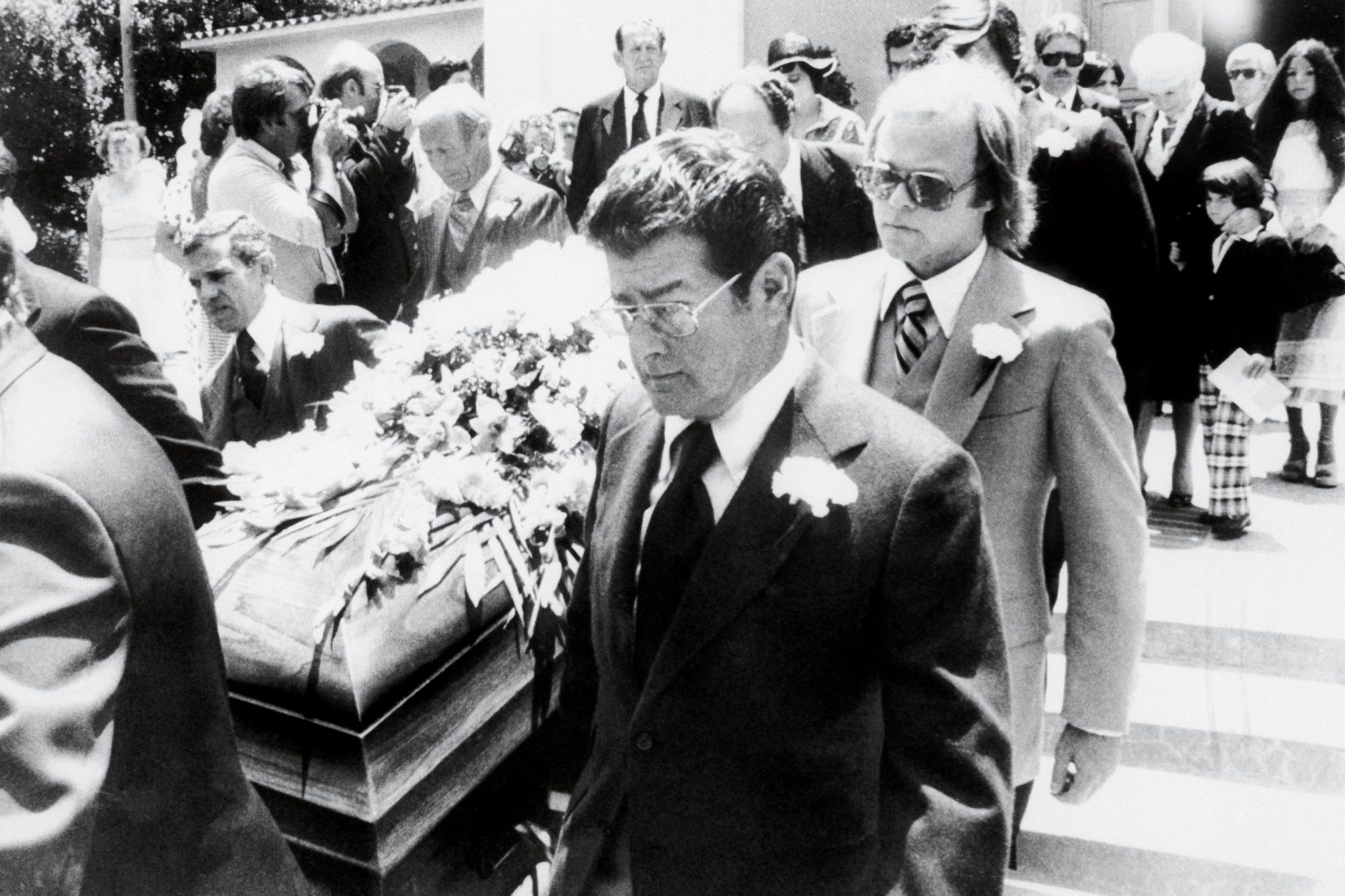 The casket containing the body of slain actor Bob Crane is carried down the steps of St. Paul the Apostle church following the funeral service on July 5, 1978. Among the pallbearers were Crane's son Robert Jr., as well as two other members of the Hogan's Heroes cast, Robert Clary (L) and Larry Hovis (C).