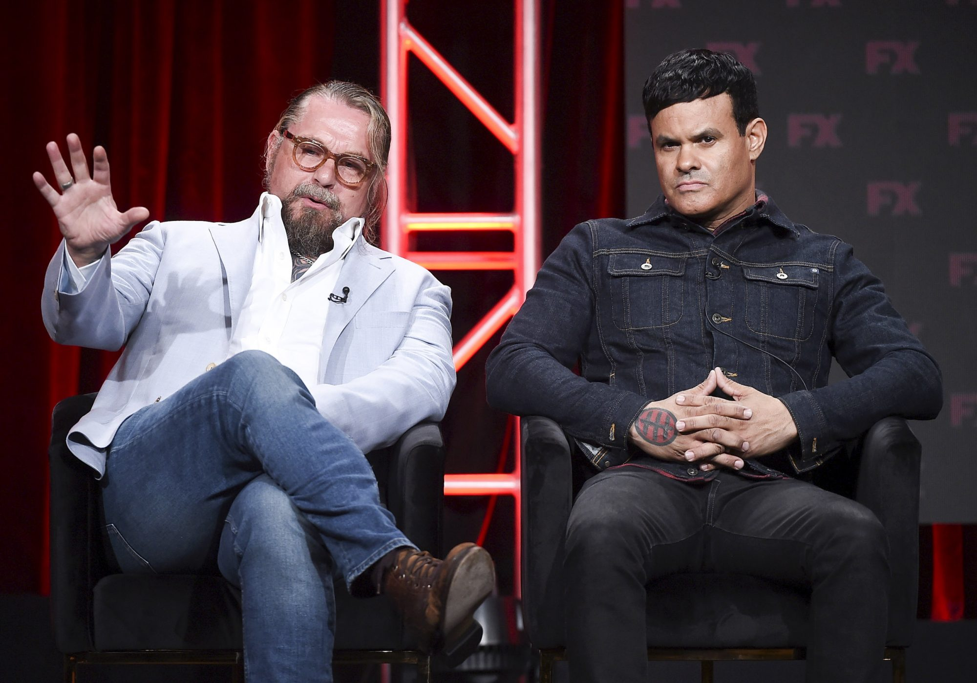 "BEVERLY HILLS - AUGUST 6: (L-R) Co-Creators/Executive Producers/Writers Kurt Sutter and Elgin James onstage during the ""Mayans M.C."" panel at the FX Networks portion of the Summer 2019 TCA Press Tour at the Beverly Hilton on August 6, 2019 in Los Angeles, California. (Photo by Frank Micelotta/FX Networks/PictureGroup)"