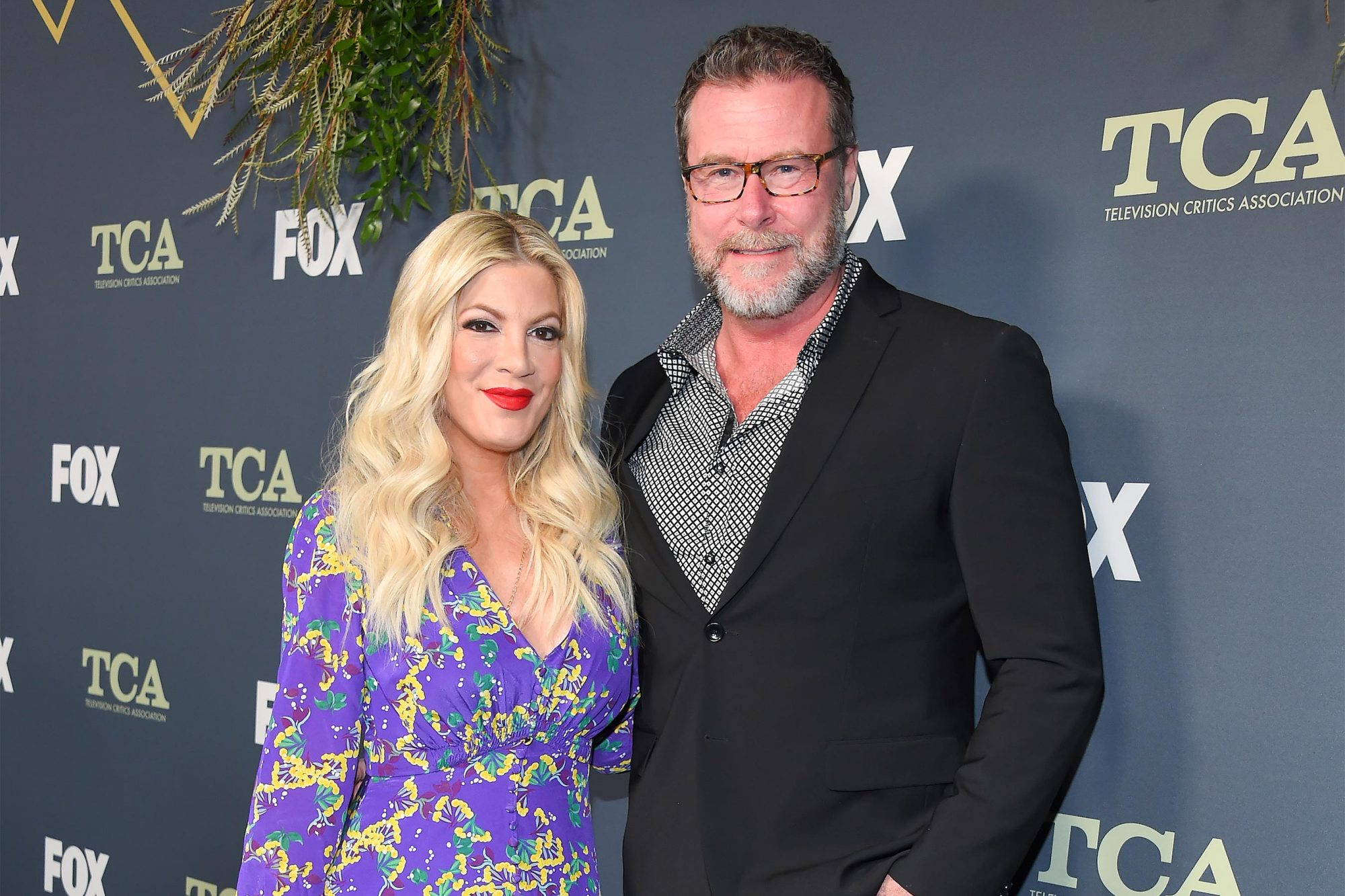 Actress Tori Spelling (L) and husband actor Dean McDermott arrive at the FOX Winter TCA All-Star Party 2019 at The Fig House in Los Angeles, on February 6, 2019. (Photo by LISA O'CONNOR / AFP) (Photo credit should read LISA O'CONNOR/AFP/Getty Images)
