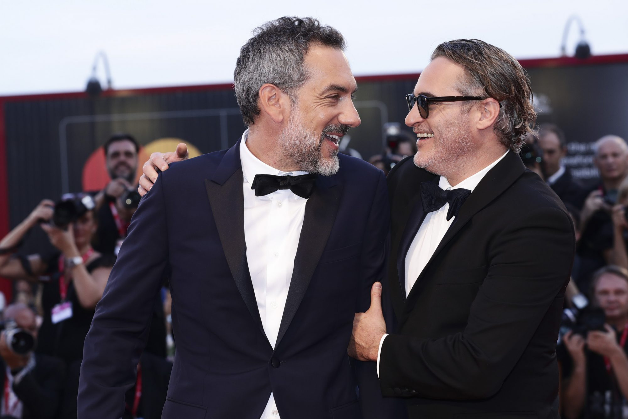 "VENICE, ITALY - AUGUST 31: Joaquin Phoenix and Director Todd Phillips walk the red carpet ahead of the ""Joker"" screening during the 76th Venice Film Festival at Sala Grande on August 31, 2019 in Venice, Italy. (Photo by Vittorio Zunino Celotto/Getty Images)"