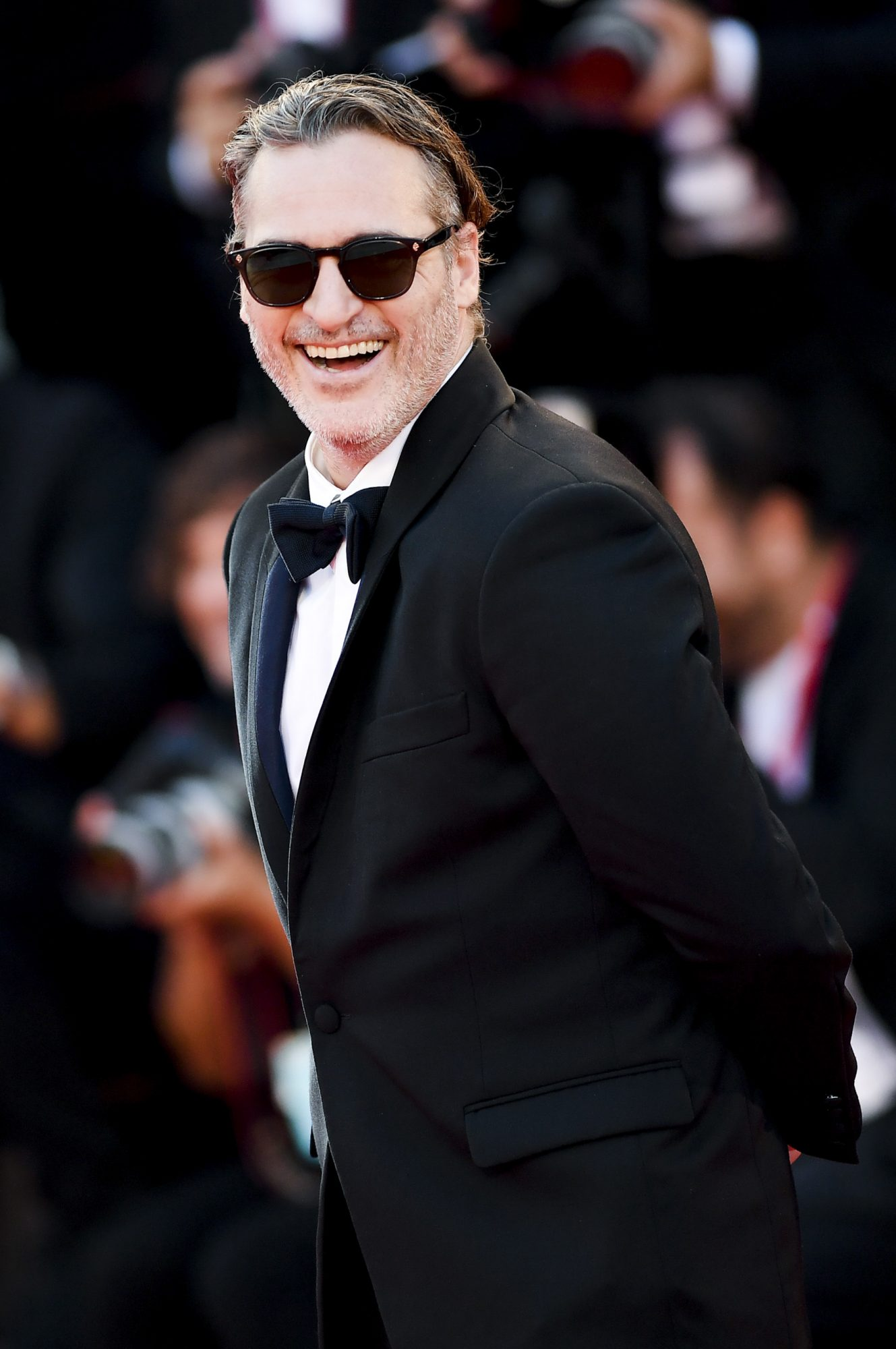 "VENICE, ITALY - AUGUST 31: Joaquin Phoenix walks the red carpet ahead of the ""Joker"" screening during the 76th Venice Film Festival at Sala Grande on August 31, 2019 in Venice, Italy. (Photo by Jacopo Raule/Getty Images)"