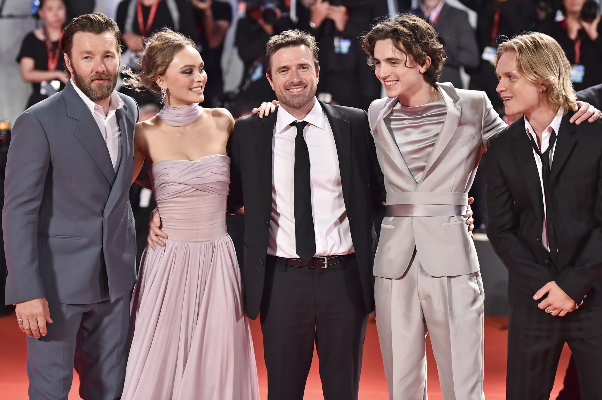 "VENICE, ITALY - SEPTEMBER 02: (R-L) Tom Glynn-Carney, Timothée Chalamet, director David Michod, Lily-Rose Depp and Joel Edgerton attend ""The King"" red carpet during the 76th Venice Film Festival at Sala Grande on September 02, 2019 in Venice, Italy. (Photo by Theo Wargo/Getty Images)"
