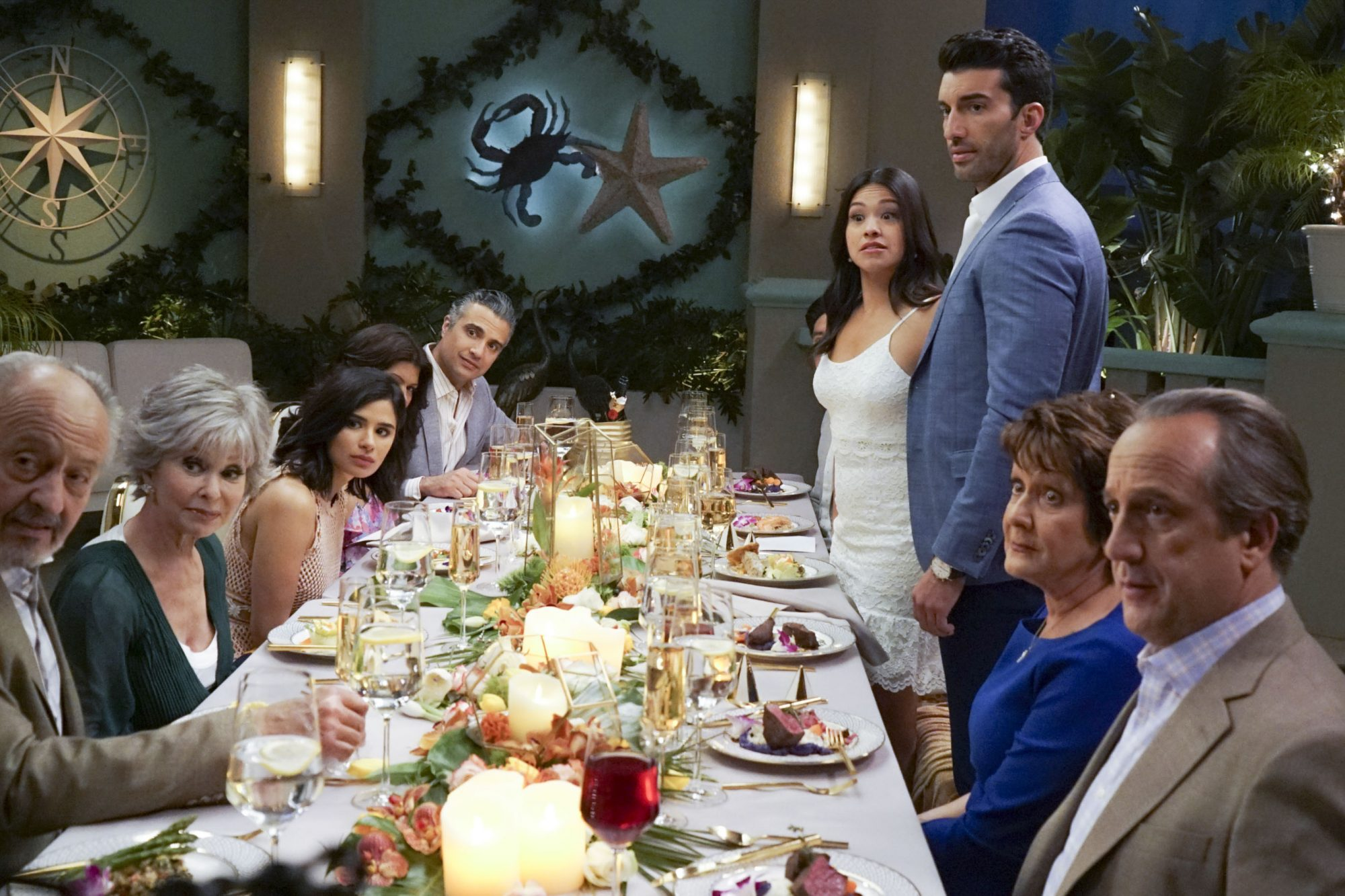 "Jane The Virgin -- ""Chapter One Hundred"" -- Image Number: JAV519a_0833.jpg -- Pictured (L-R): Castillo Guerra as Manuel, Rita Moreno as Liliana, Diane Guerrero as Lina, Andrea Navedo as Xo, Jaime Camil as Rogelio, Gina Rodriguez as Jane, Justin Baldoni as Rafael, Ivonne Coll as Alba and Alfonso DiLuca as Jorge -- Photo: Kevin Estrada/The CW -- © 2019 The CW Network, LLC. All Rights Reserved."