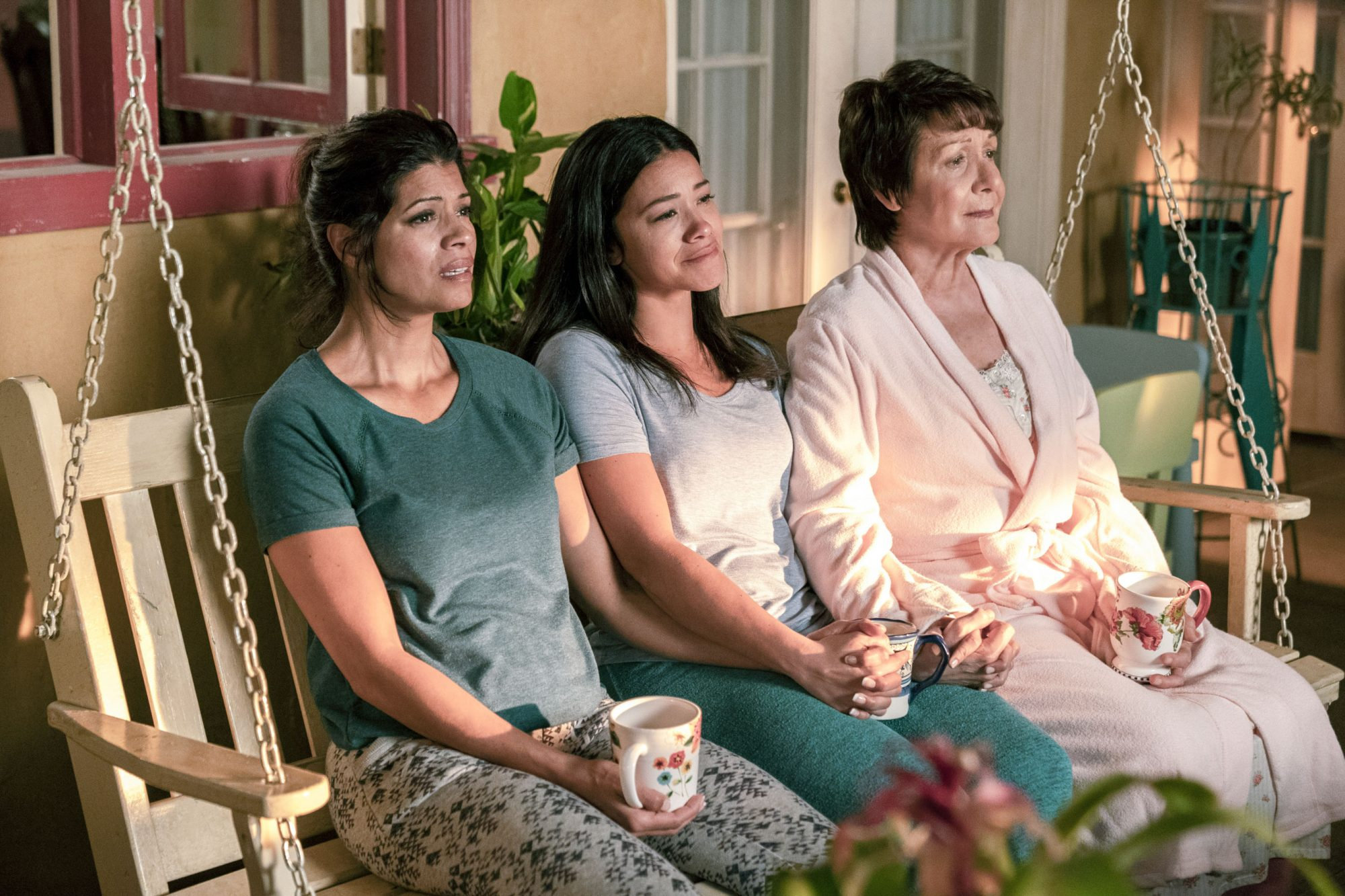 "Jane The Virgin -- ""Chapter One Hundred"" -- Image Number: JAV519b_0116.jpg -- Pictured (L-R): Andrea Navedo as Xo, Gina Rodriguez as Jane and Ivonne Coll as Alba -- Photo: Lisa Rose/The CW -- © 2019 The CW Network, LLC. All Rights Reserved."