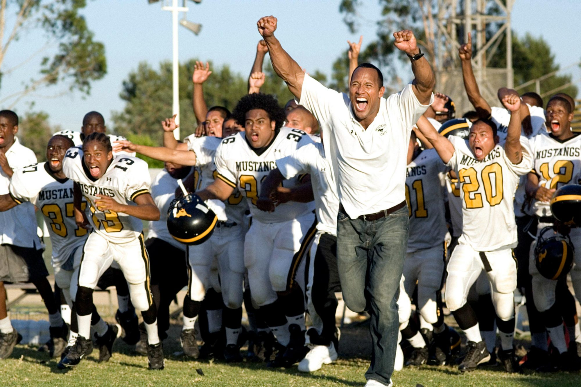 GRIDIRON GANG, Dwayne 'The Rock' Johnson (center right), 2006. ©Columbia Pictures/courtesy Everett C