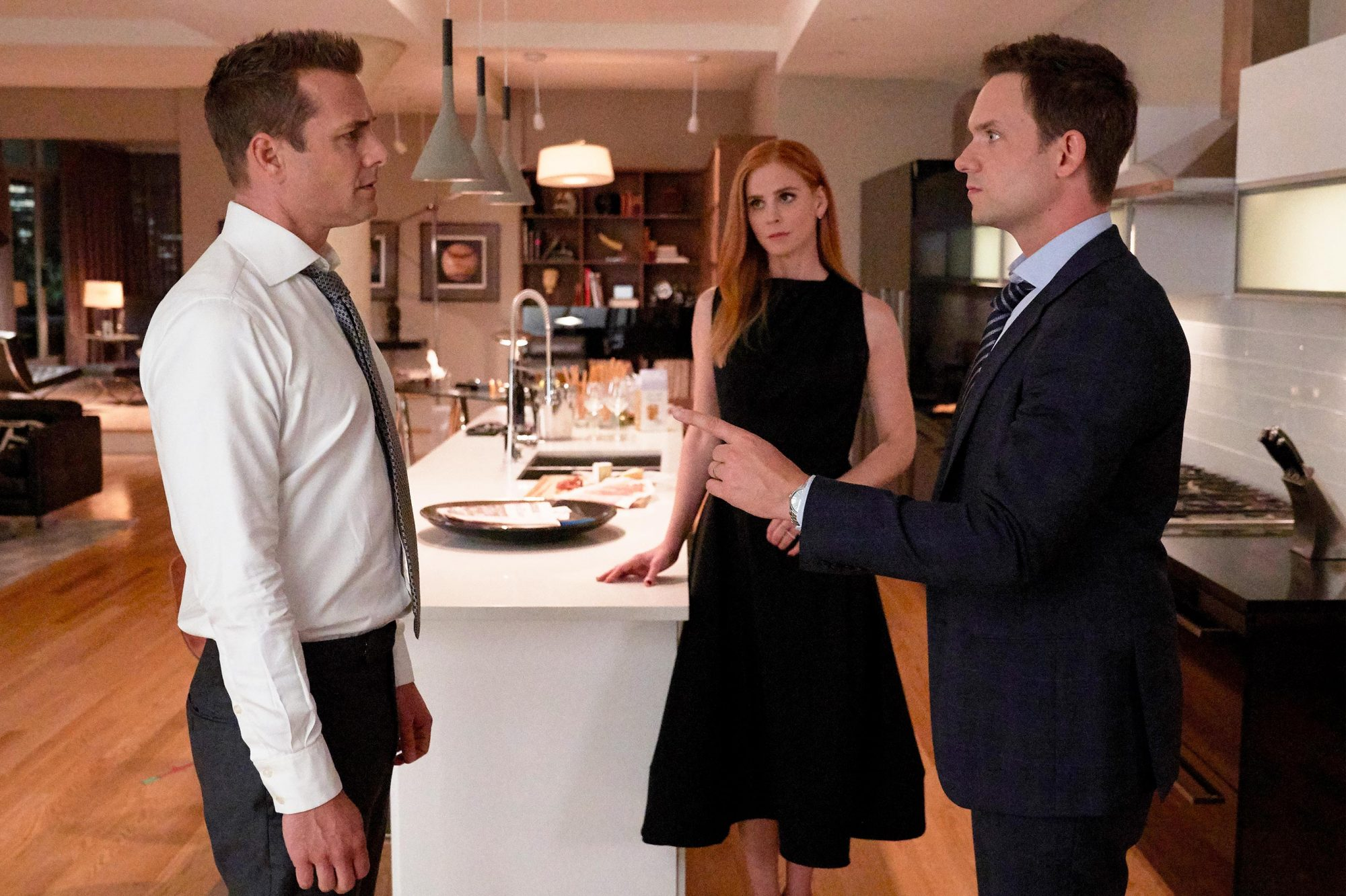 "SUITS -- ""If the Shoe Fits"" Episode 905 -- Pictured: (l-r) Gabriel Macht as Harvey Specter, Sarah Rafferty as Donna Paulsen, Patrick J. Adams as Mike Ross -- (Photo by: Shane Mahood/USA Network)"