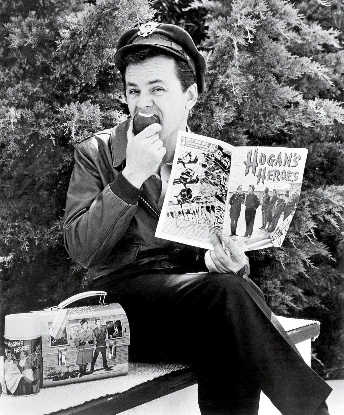HOGAN'S HEROES, Bob Crane with thermos, lunchbox and comic book all product spinoffs from the show, 1965-1971