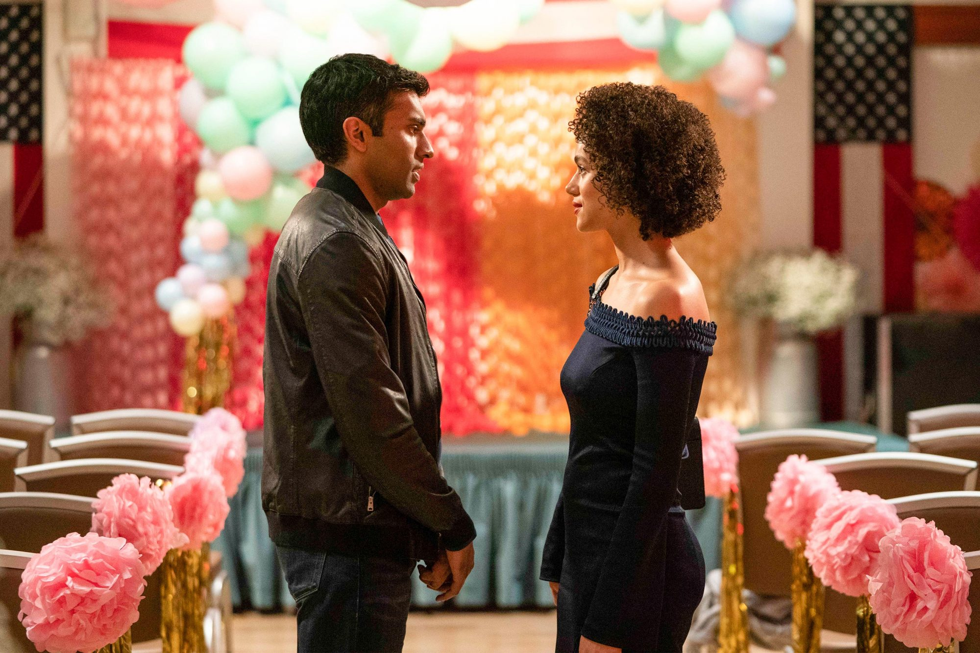 "Four Weddings and A Funeral - ""New Jersey"" - Episode 110 -- A year after Maya and Ainsley's blowup, the fractured friend group hopes that a wedding may be the perfect occasion for a reunion. Kash (Nikesh Patel) and Maya (Nathalie Emmanuel), shown. (Photo by: Robert Viglasky/Hulu)"