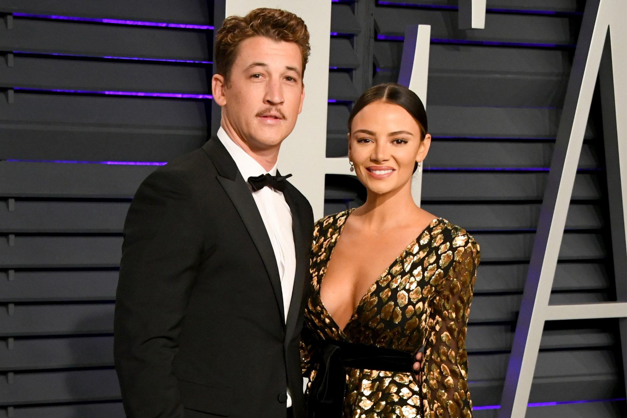 BEVERLY HILLS, CA - FEBRUARY 24: (L-R) Miles Teller and Keleigh Sperry attend the 2019 Vanity Fair Oscar Party hosted by Radhika Jones at Wallis Annenberg Center for the Performing Arts on February 24, 2019 in Beverly Hills, California. (Photo by Jon Kopaloff/WireImage)