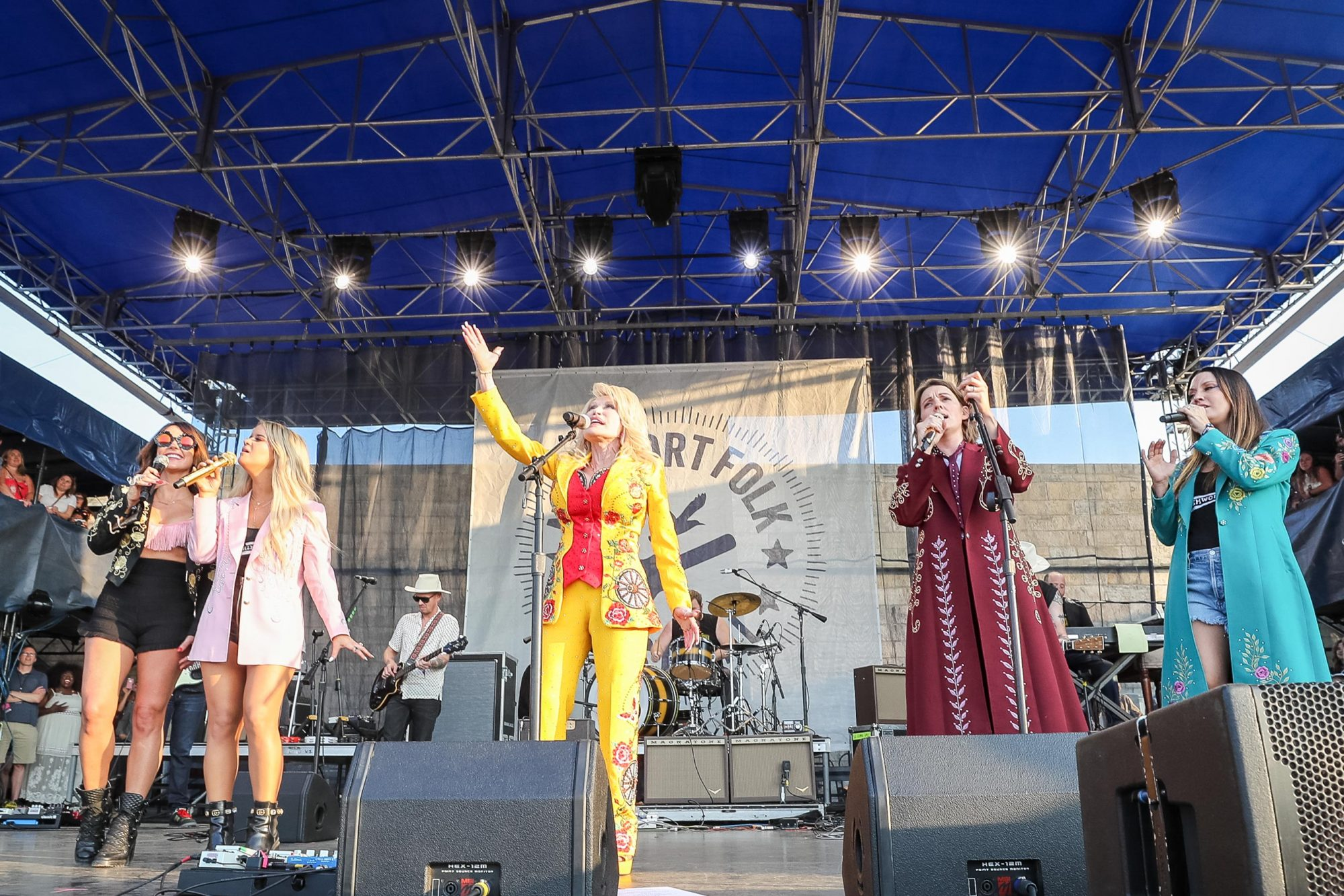 NEWPORT, RHODE ISLAND - JULY 27: (L-R) Amanda Shires, Maren Morris, Dolly Parton, Brandi Carlile and Natalie Hemby performs during the Newport Folk Festival 2019, the 60th anniversary, at Fort Adams State Park on July 27, 2019 in Newport, Rhode Island. (Photo by Douglas Mason/WireImage)